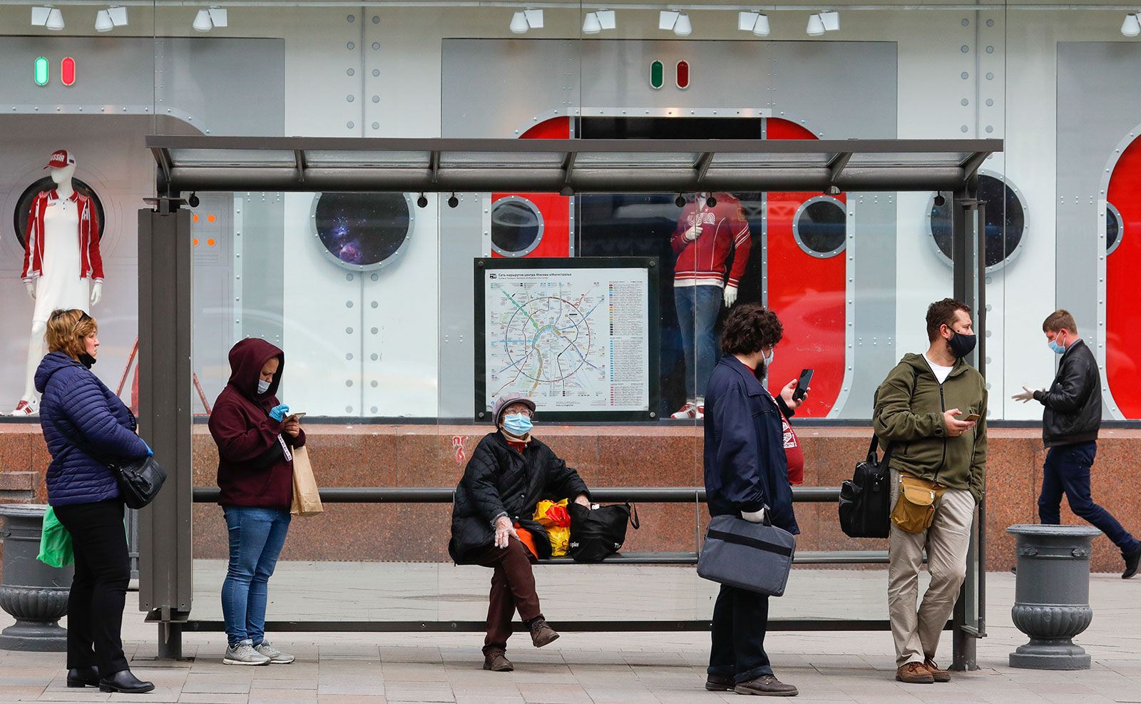People wait at a public transport stop amid the pandemic in Moscow on May 20.
