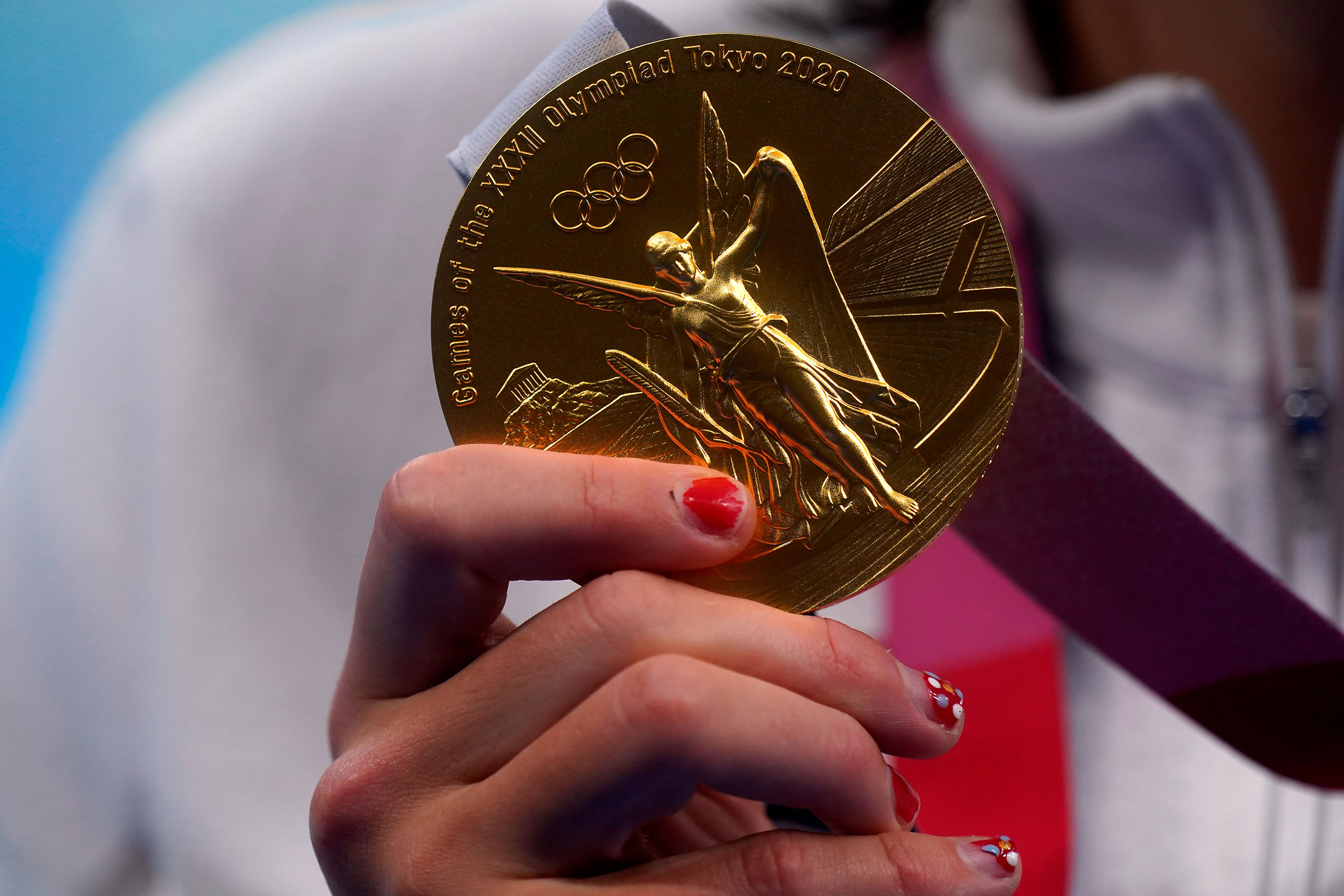 American Katie Ledecky holds her gold medal for the 800-meter freestyle on July 31.
