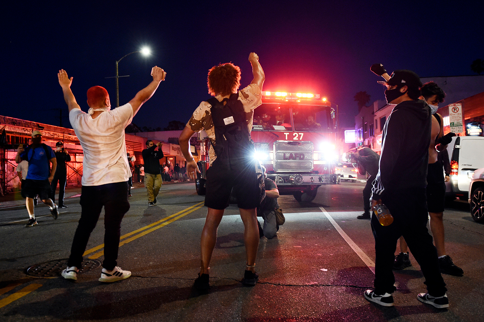 Demonstrators block the path of a Los Angeles Fire Department truck on Melrose Avenue on Saturday, May 30.