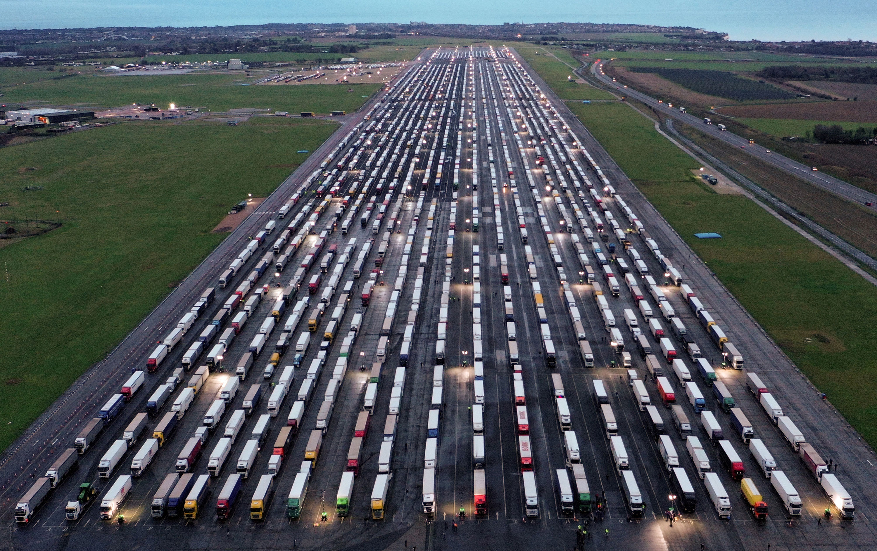 Feight lorries sit on the tarmac at Manston Airport on December 22 in Kent, England.