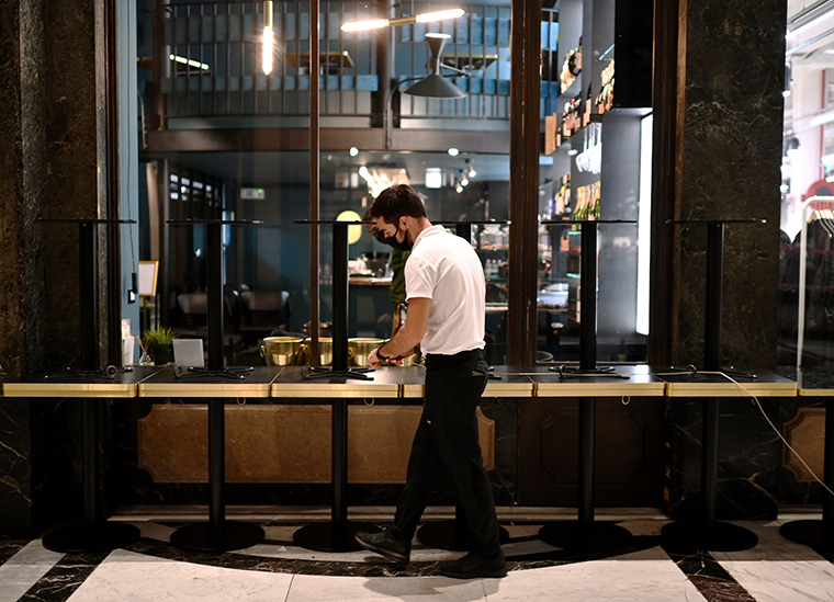 A waiter prepares to close a cafe in downtown Turin, on October 26, 2020, as the country faces a second wave of Covid-19 infections.