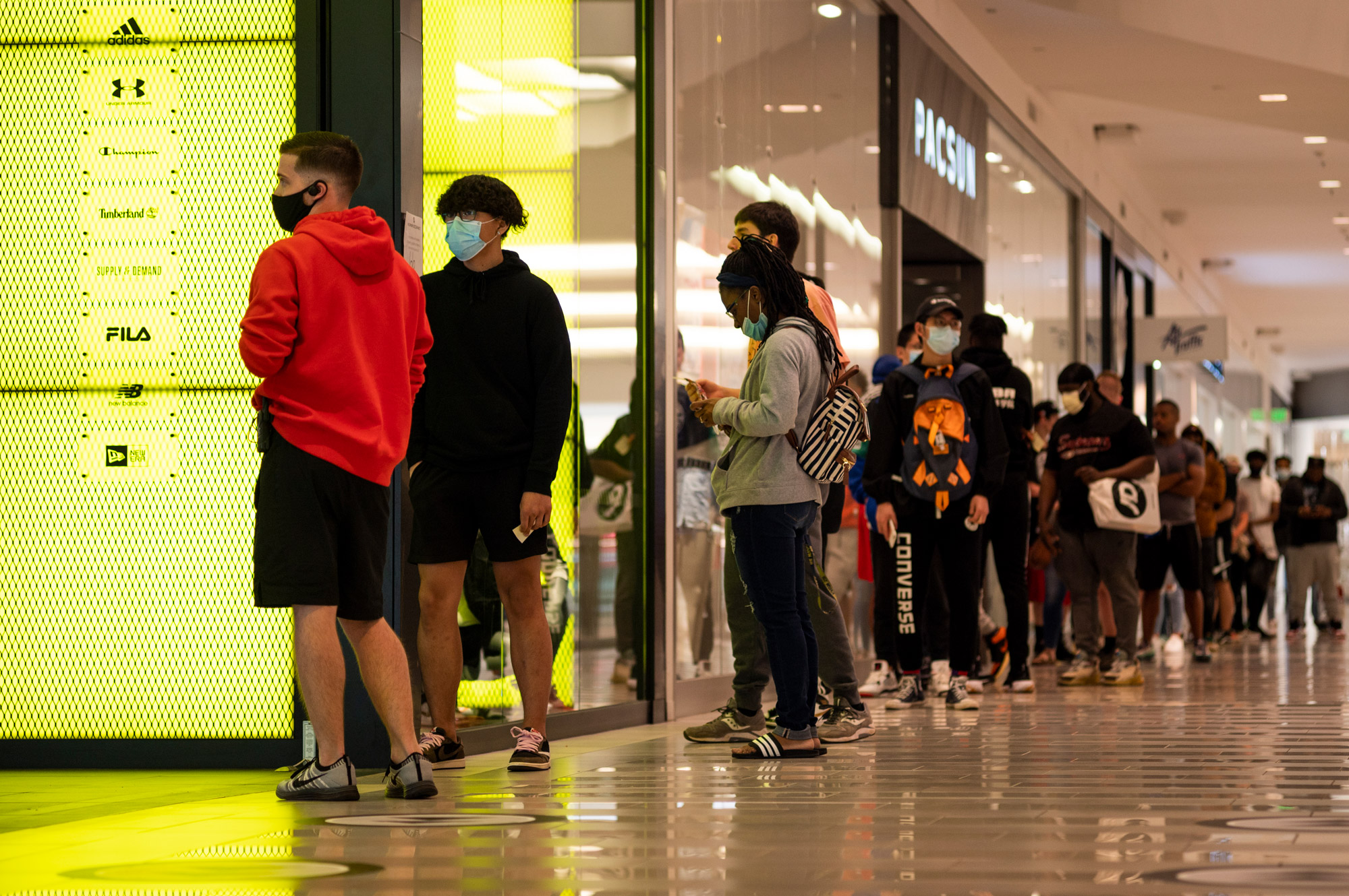 People line up at a store inside the Mall of America before it opens on June 10 in Minneapolis.