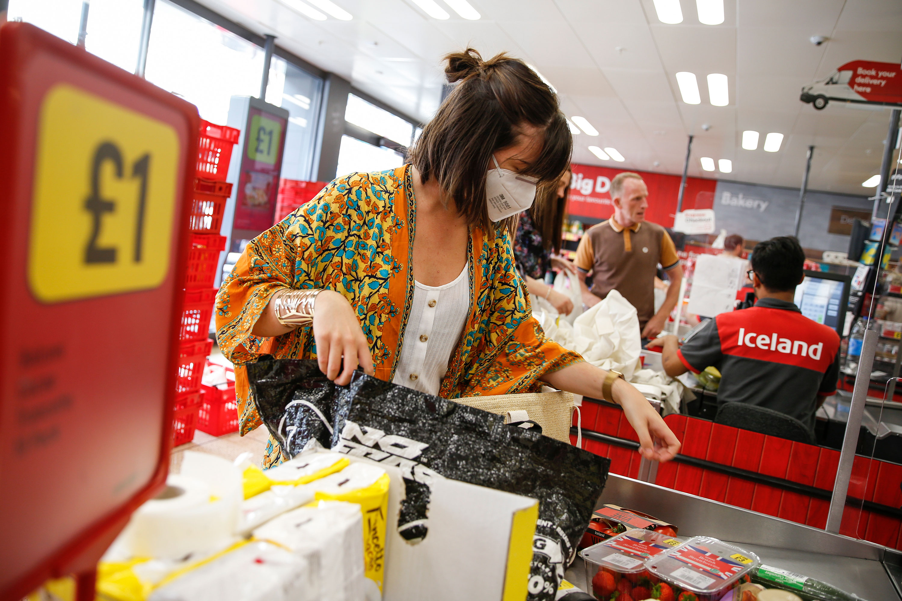 A customer wears a face mask while shopping at Iceland on July 11 in London, England.