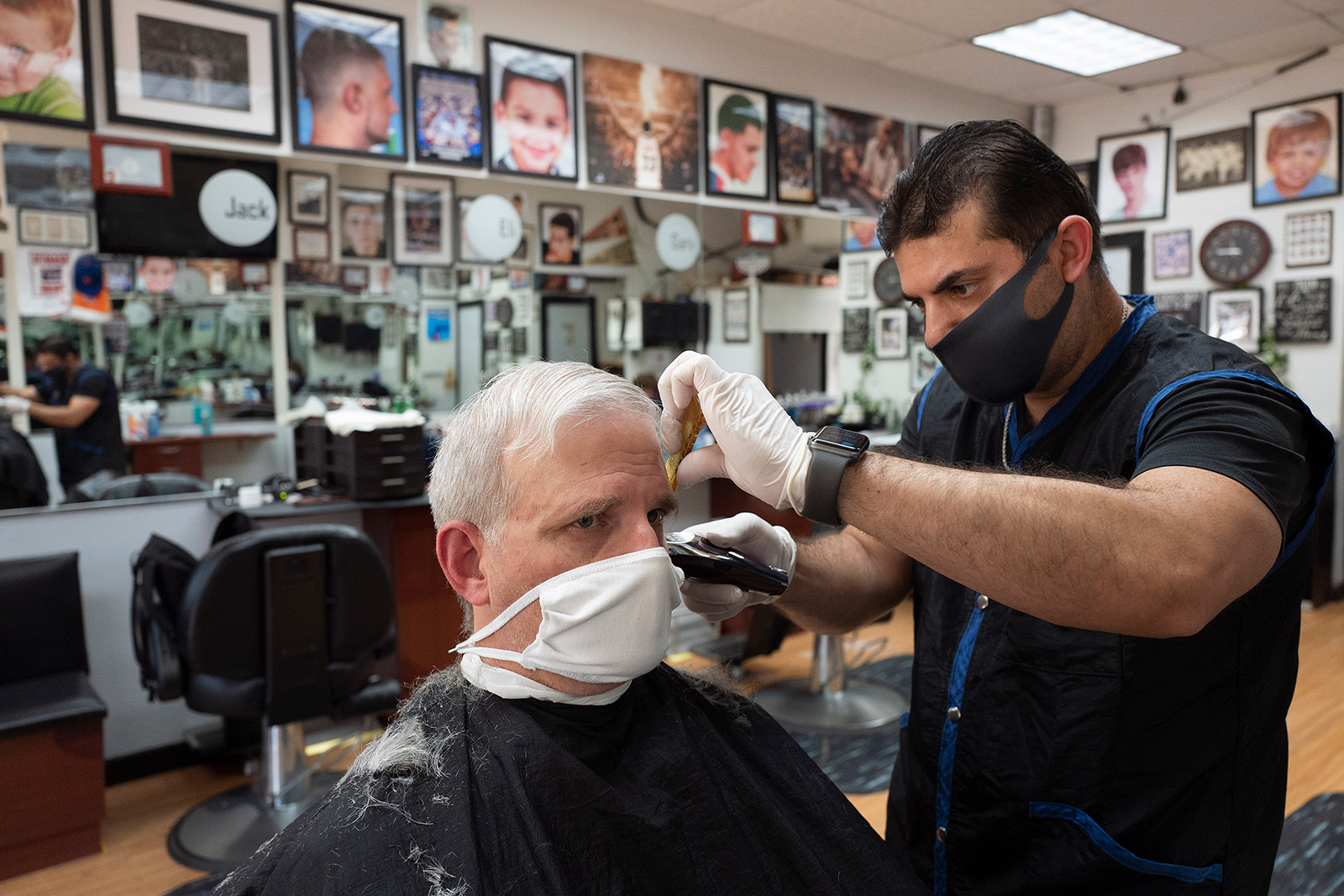 Howard Kaplan gets a haircut from Eli Gilkarov at Jack's Barbershop, on June 9, in Larchmont, New York.