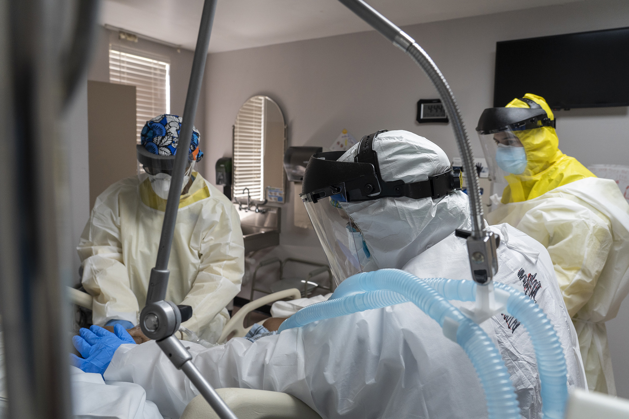 Members of the medical staff treat a patient in the COVID-19 intensive care unit at the United Memorial Medical Center on July 2, Houston, Texas.