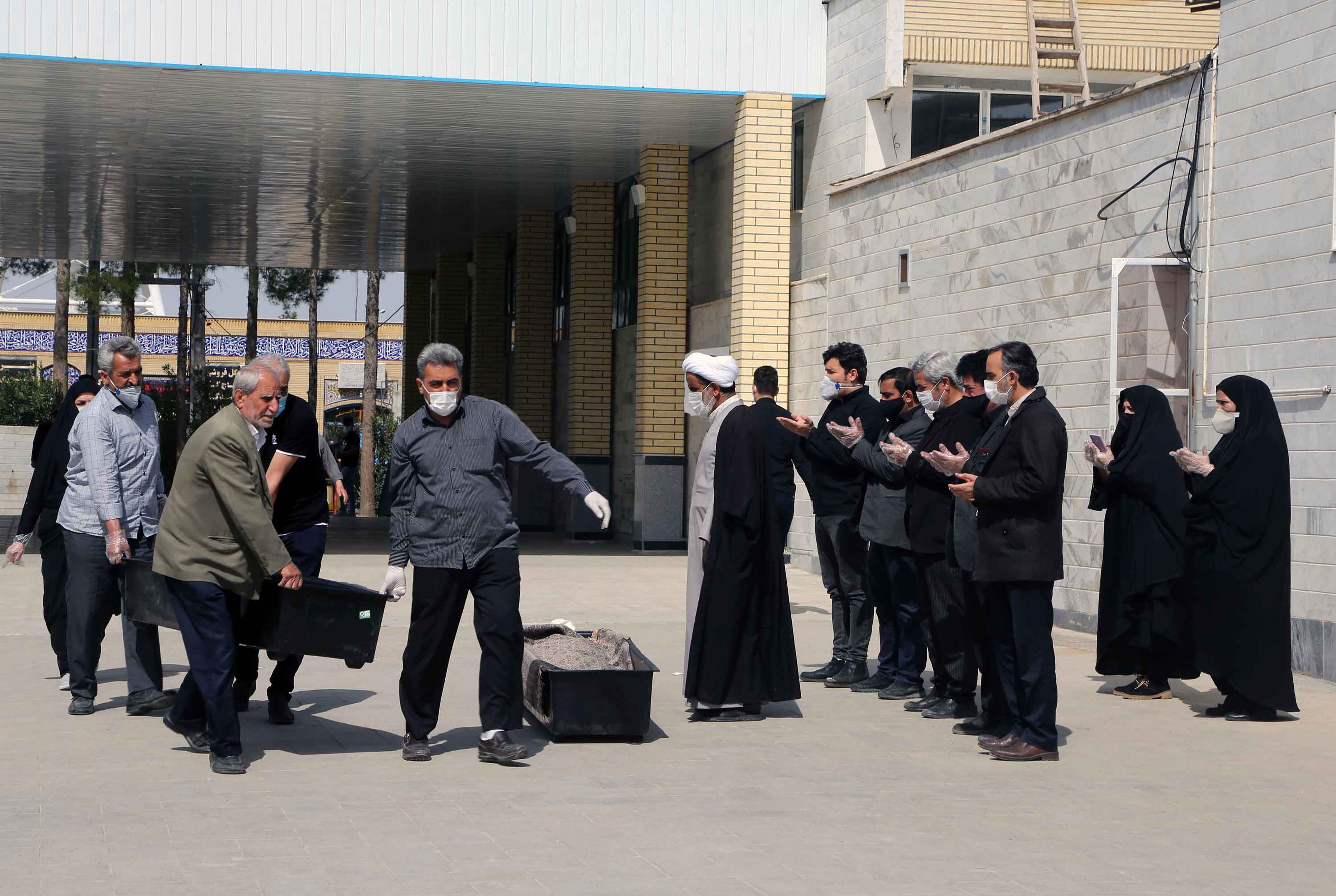 Funeral prayers are performed at Beheshte Masoumeh Cemetery for victims of the coronavirus outbreak in Qom, Iran on March 17.