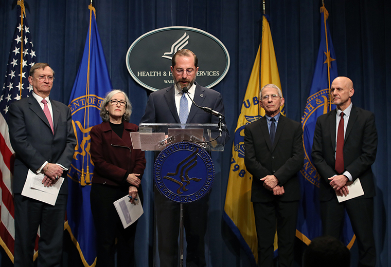 HHS Secretary Alex Azar speaks about the coronavirus while flanked by (from left to right) Assistant Secretary for Preparedness and Response Robert Kadlec, Centers for Disease Control and Prevention Principal Deputy Director Anne Schuchat, National Institute of Allergy and Infectious Diseases Director Anthony Fauci and Commissioner of Food and Drugs Stephen Hahn during a press briefing at the Department of Health and Human Services headquarters on Tuesday, February 25,  in Washington.