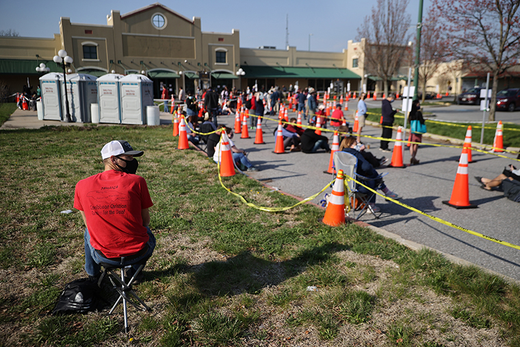 Hundreds of people without appointments stand in line outside the mass coronavirus vaccination site at Hagerstown Premium Outlets on April 07, in Hagerstown, Maryland.