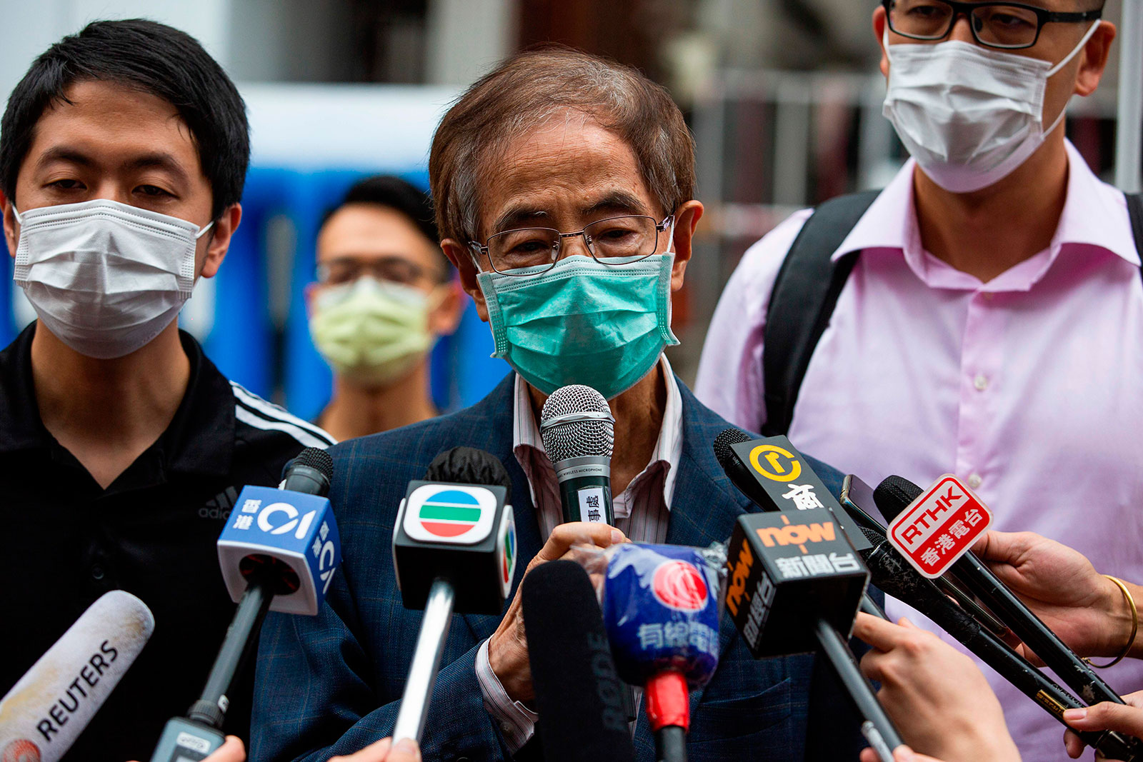 Former lawmaker and pro-democracy activist Martin Lee talks to members of the media as he leaves the Central District police station in Hong Kong on April 18.