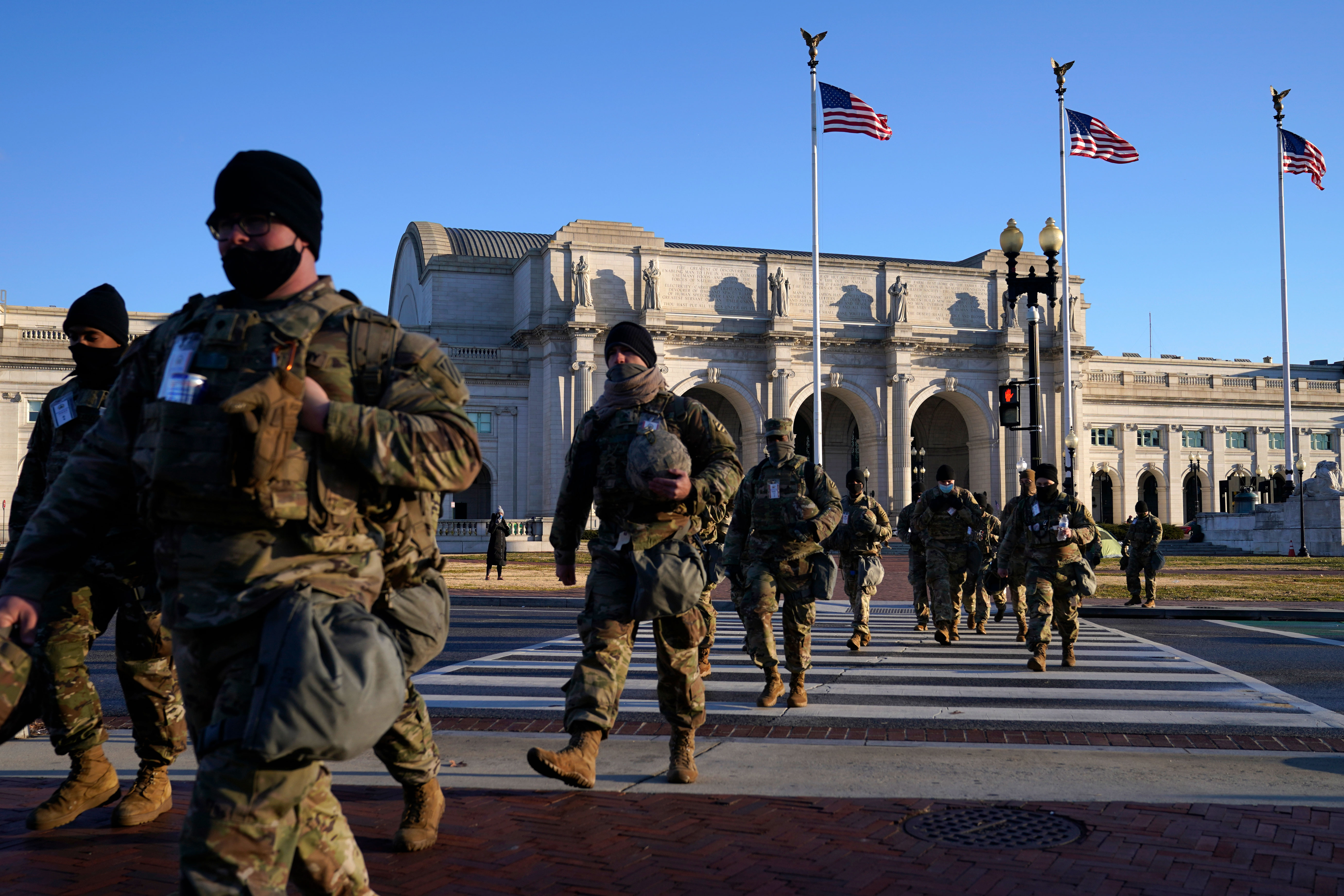 Members of the National Guard walk from Union Station to the Capitol in Washington, DC, as events get under way for Joe Biden's inauguration ceremony on January 20.