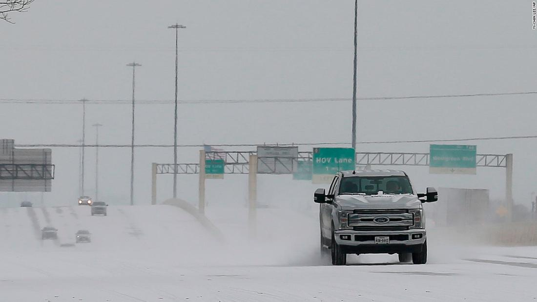 Vehicles driving on snow-covered Interstate 10 Monday in Houston