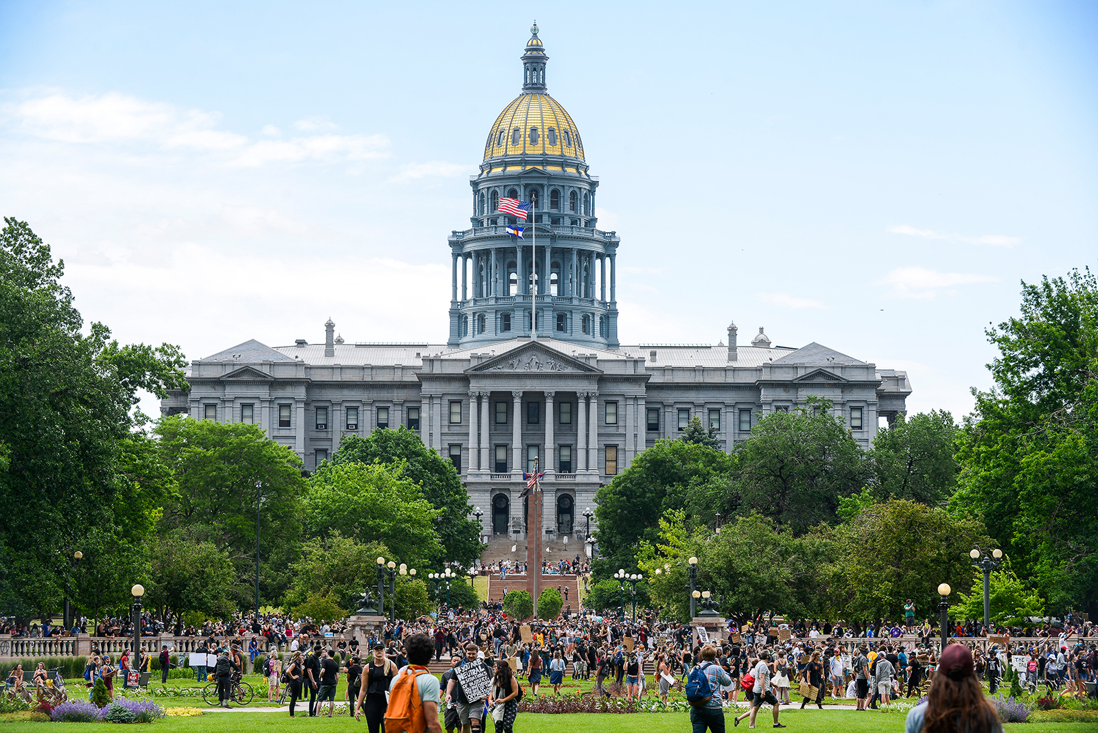 People protest in front of the Colorado State Capitol on Saturday, June 6, in Denver.
