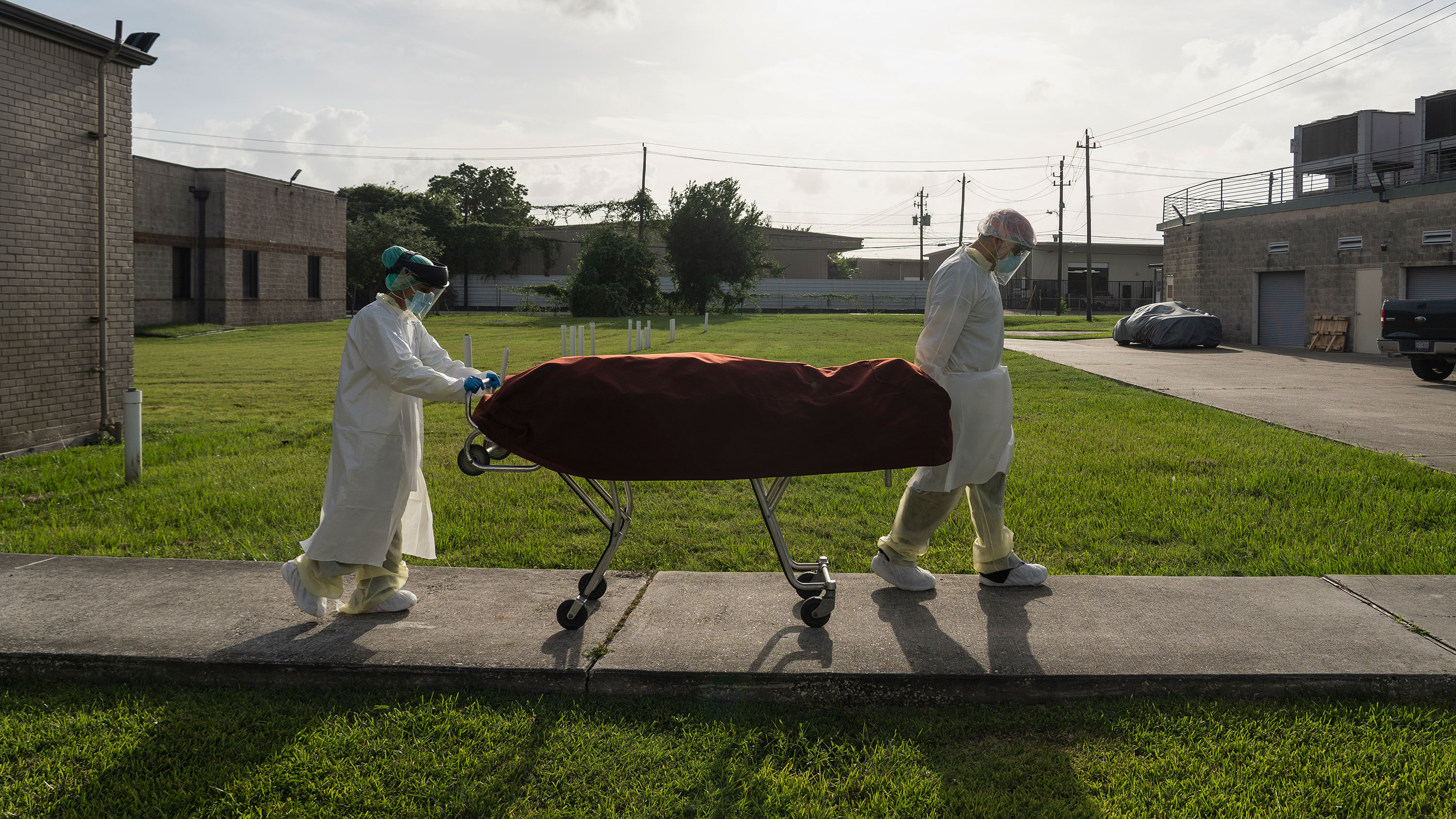 Medical staff transport a deceased patient outside of the Covid-19 intensive care unit at the United Memorial Medical Center on June 30 in Houston, Texas.