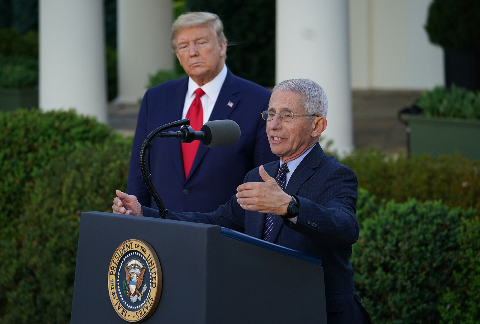 President Donald Trump listens as National Institute of Allergy and Infectious Diseases Director Dr. Anthony Fauci speaks during a Coronavirus Task Force press briefing in the Rose Garden of the White House in Washington, DC, on March 30.