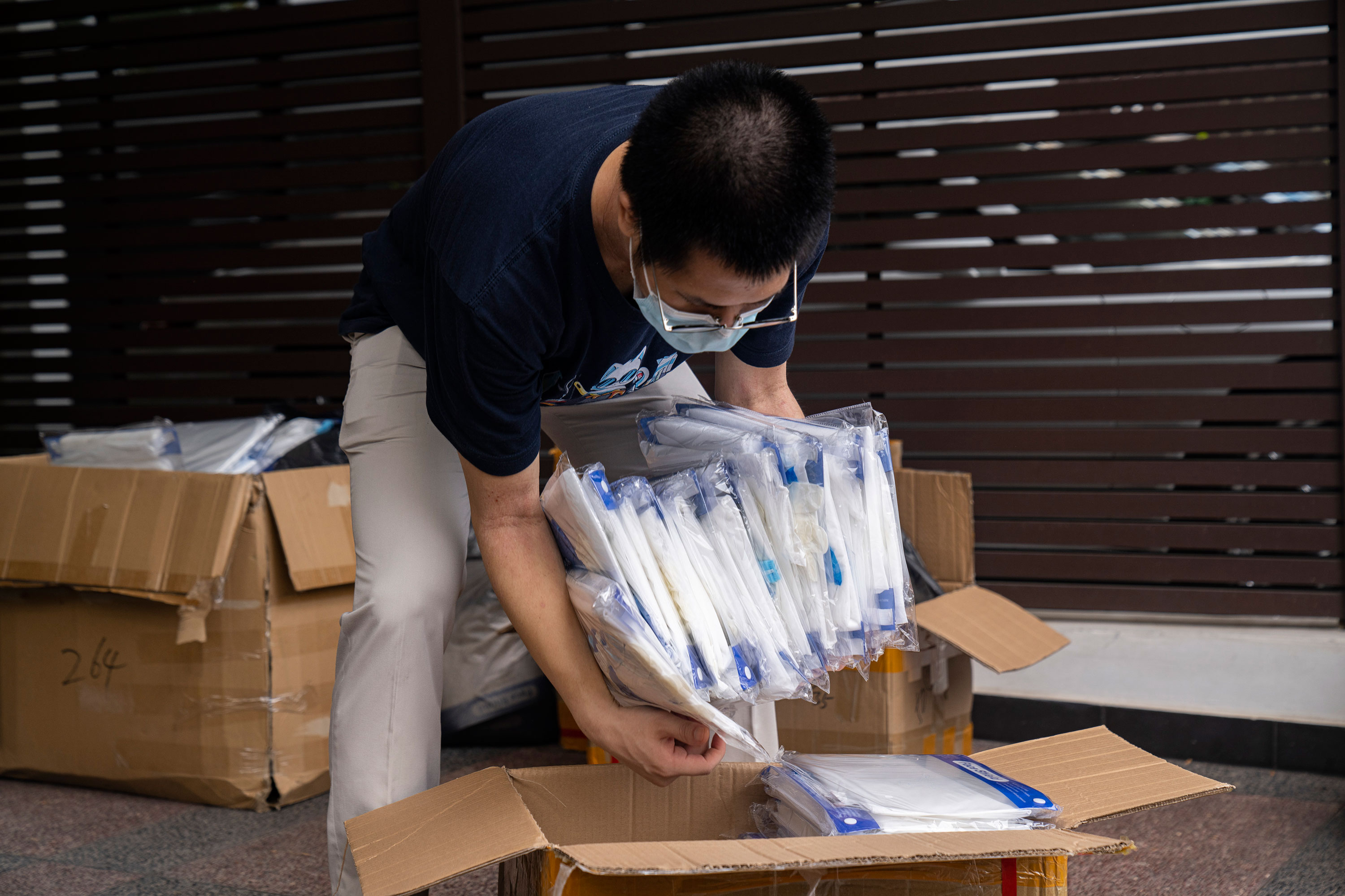A volunteer packs personal protective equipment to be distributed to migrant workers on May 23 in Singapore.
