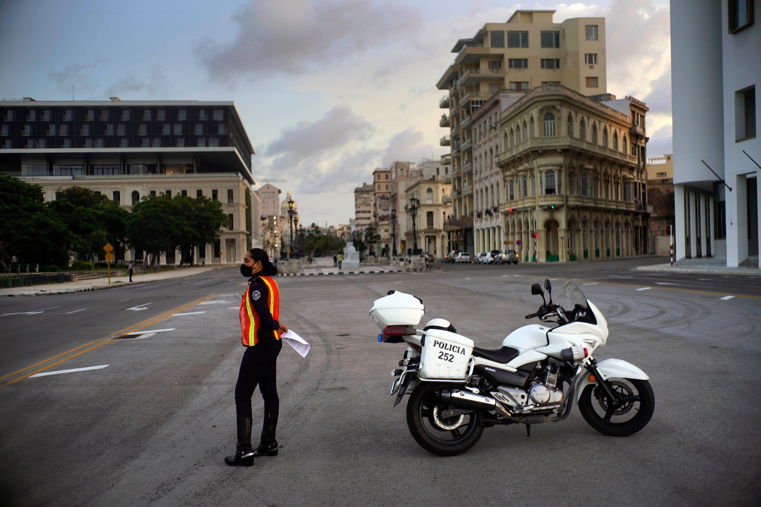 A police officer keeps watch on a street in Havana, Cuba after the government-imposed curfew on September 1.