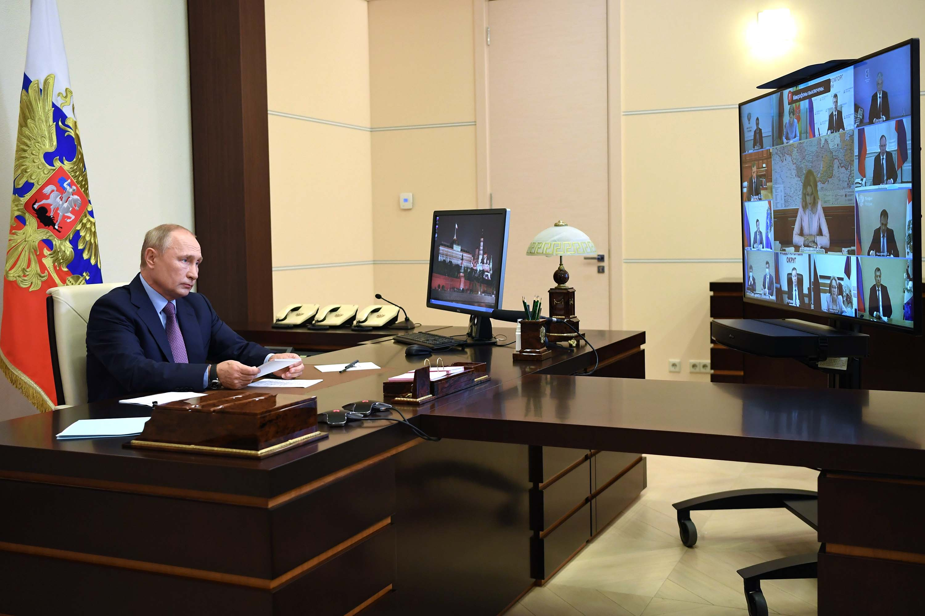 Russia's President Vladimir Putin chairs a government meeting via videoconference from his office in the Novo-Ogaryovo residence in Moscow, on July 29.