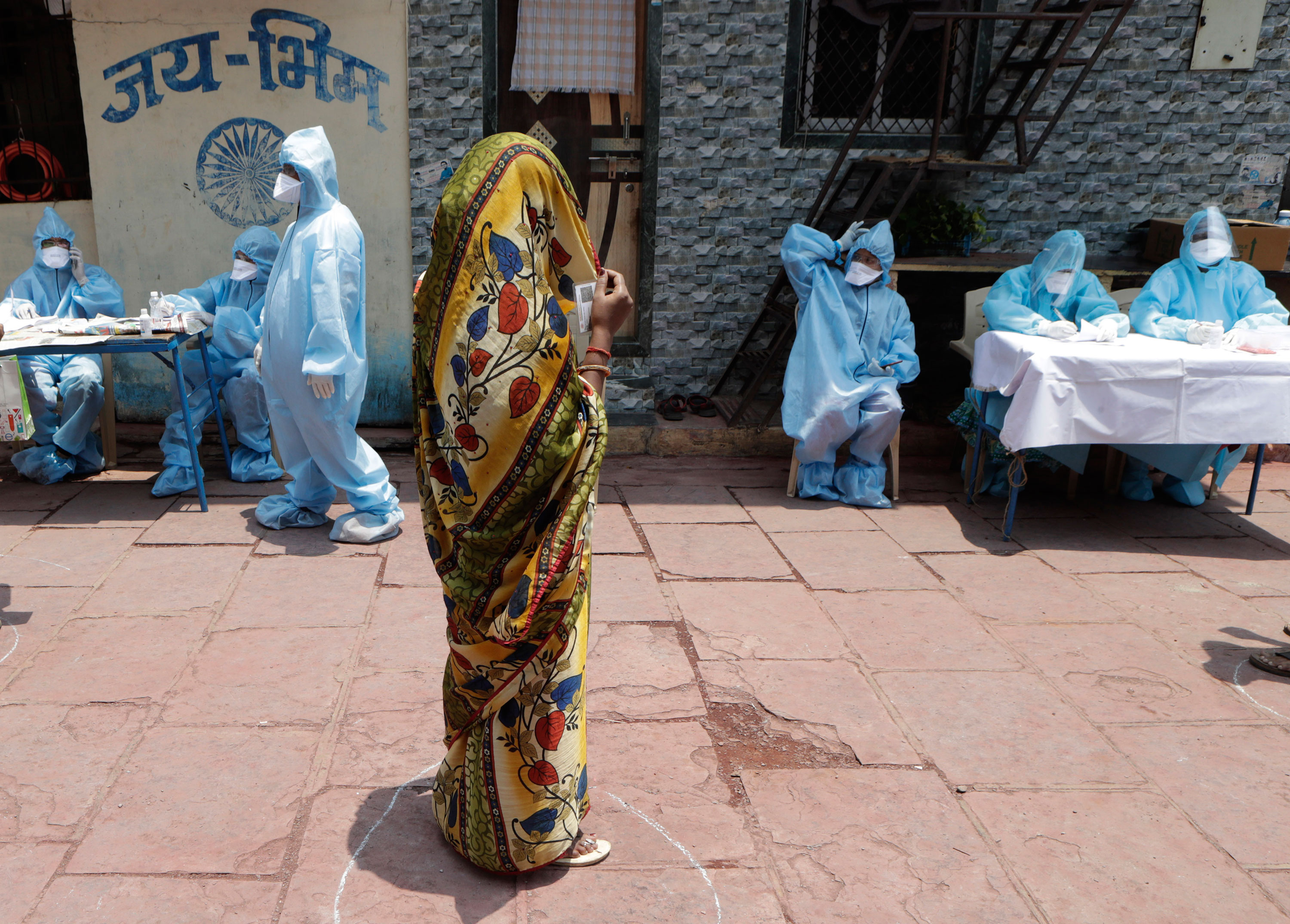 A woman waits for her turn for a free medical check in Mumbai, India, on April 18.