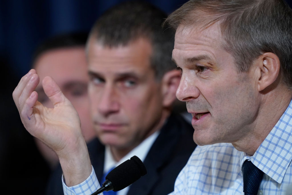 Rep. Jim Jordan questions Fiona Hill, the National Security Council's former senior director for Europe and Russia and David Holmes, an official from the American embassy in Ukraine, during an impeachment hearing held by the House Intelligence Committee.