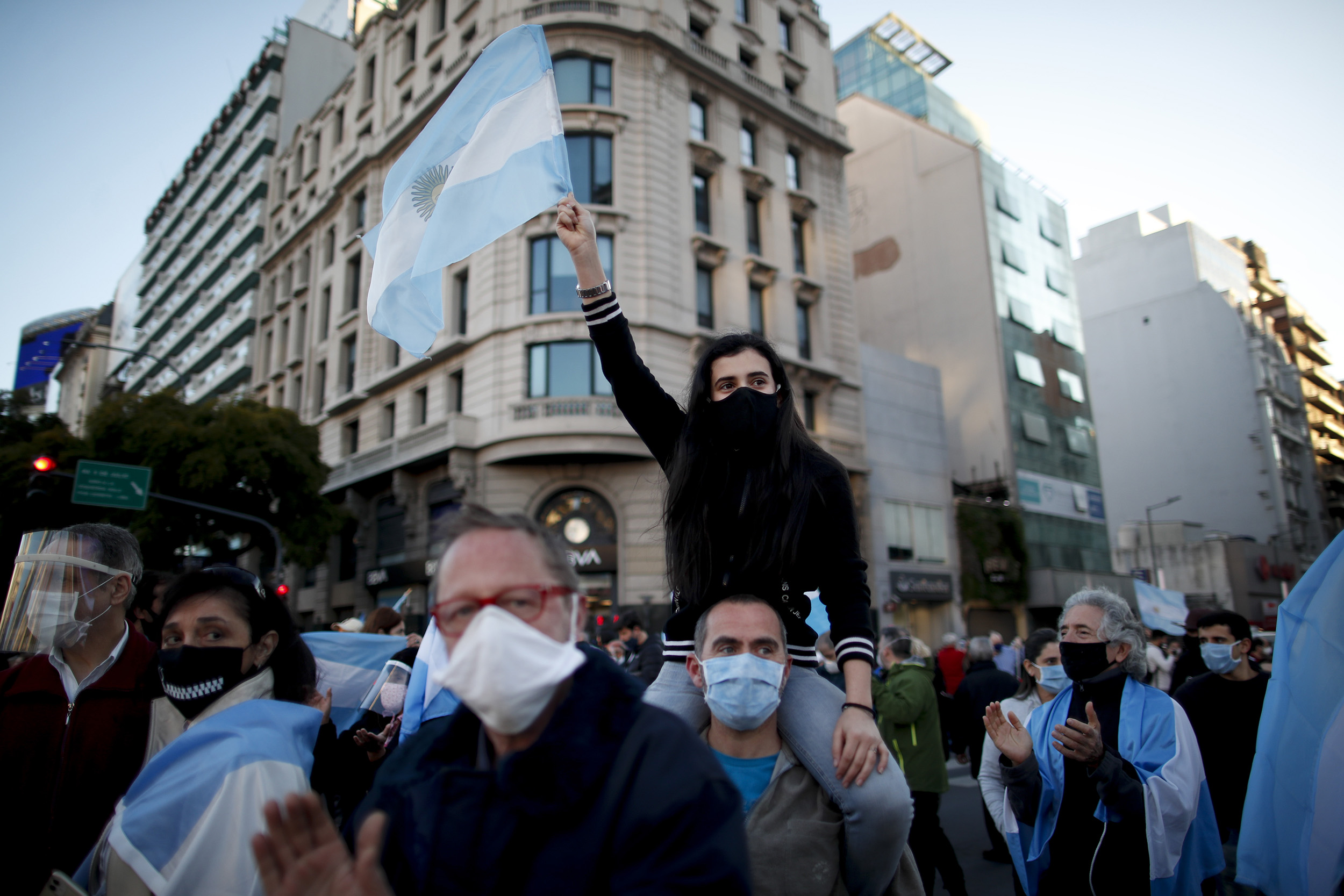 People protest the government's quarantine policies to contain Covid-19 in Buenos Aires, Argentina, on Monday, August 17.