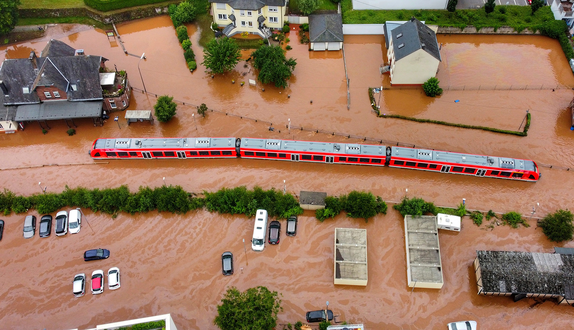 A regional train sits in the flood waters at the local station in Kordel, Germany, on Thursday July 15, after it was flooded by the high waters of the Kyll river.