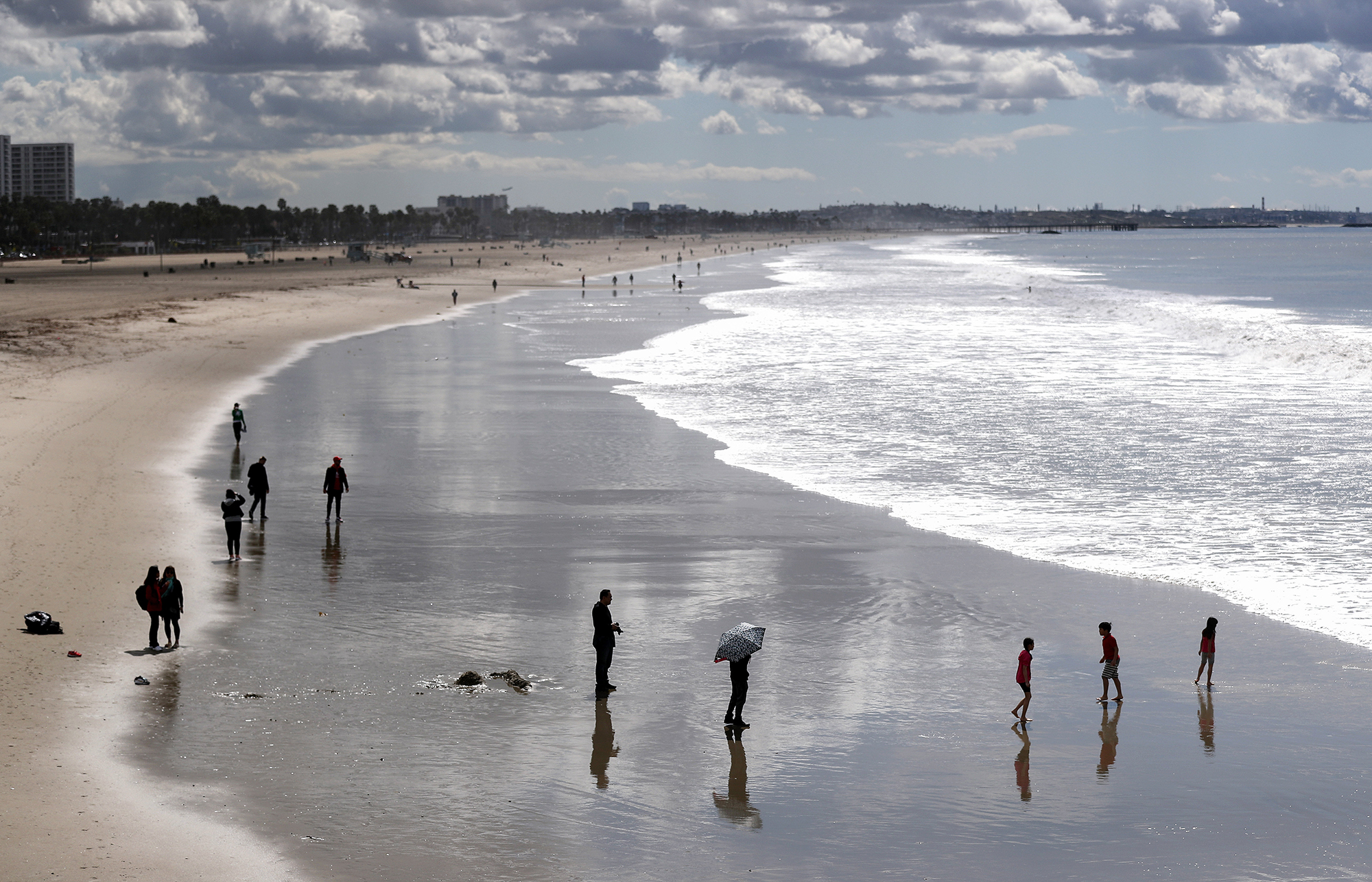 People gather on Santa Monica beach in California on March 17.