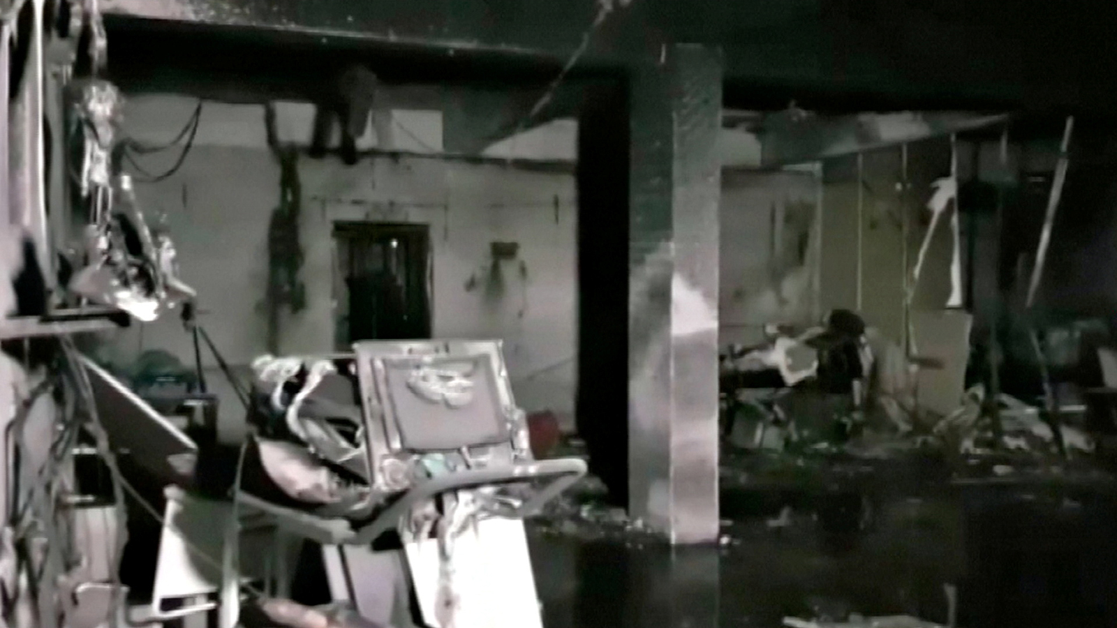 Damaged equipment and furniture are seen in the burnt interior of a hospital treating coronavirus patients, after a deadly fire, in India's western Gujarat state, May 1, in this still image obtained from video.