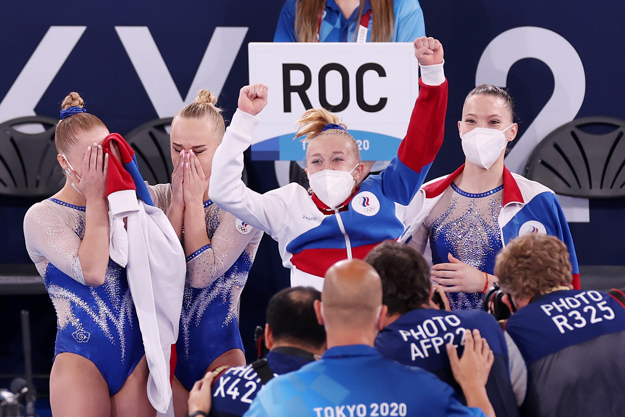 Team ROC celebrates winning the gold medal during the gymnastics Women's Team Final on July 27.
