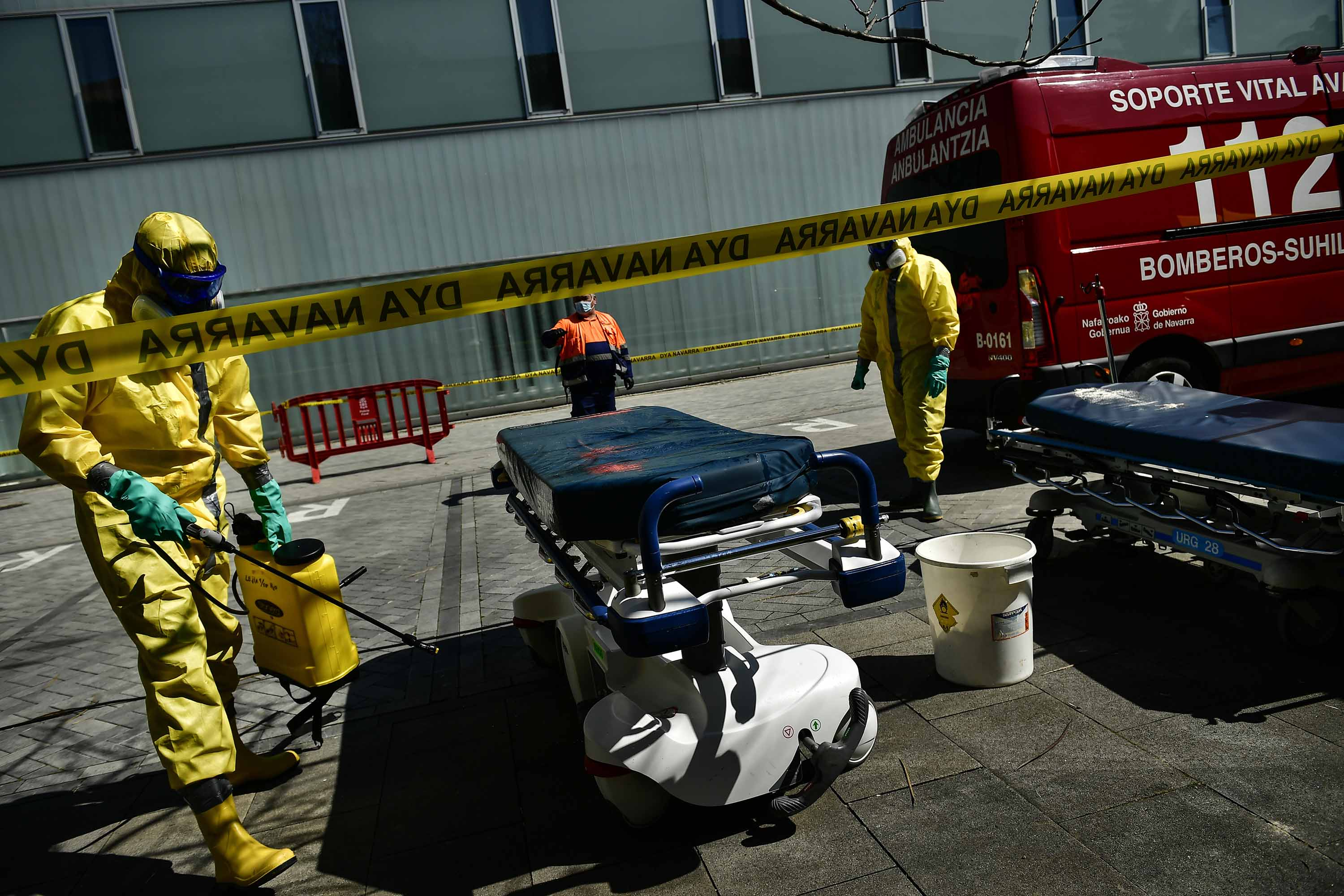 Volunteer workers from a regional search and rescue crew disinfect a stretcher in Pamplona, Spain, on March 26.
