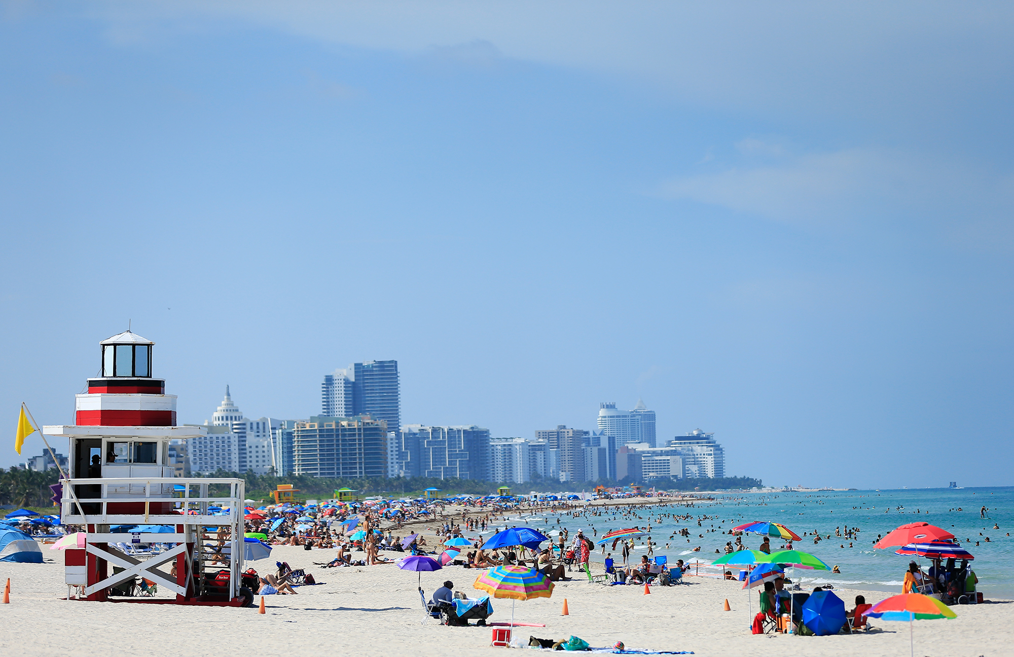 Beachgoers on South Beach on June 10, 2020 in Miami Beach, Florida as the area eased restrictions put in place to contain COVID-19.