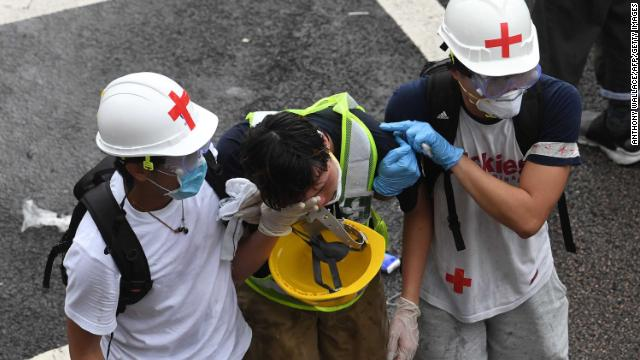 A protester is helped by medical volunteers after being hit with tear gas fired by police during the protests on June 12 in Hong Kong.