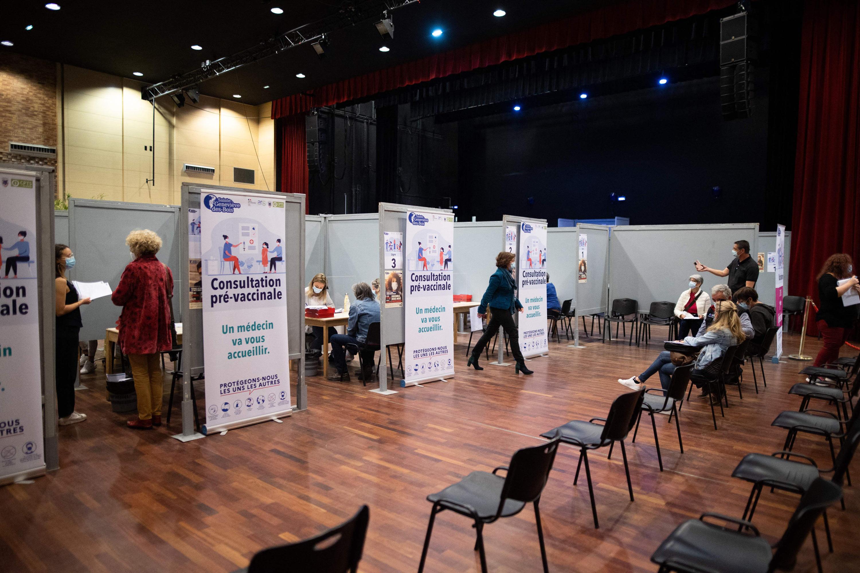 Patients wait at a Covid-19 vaccination center in Sainte-Genevieve-des-Bois, France, on April 24.