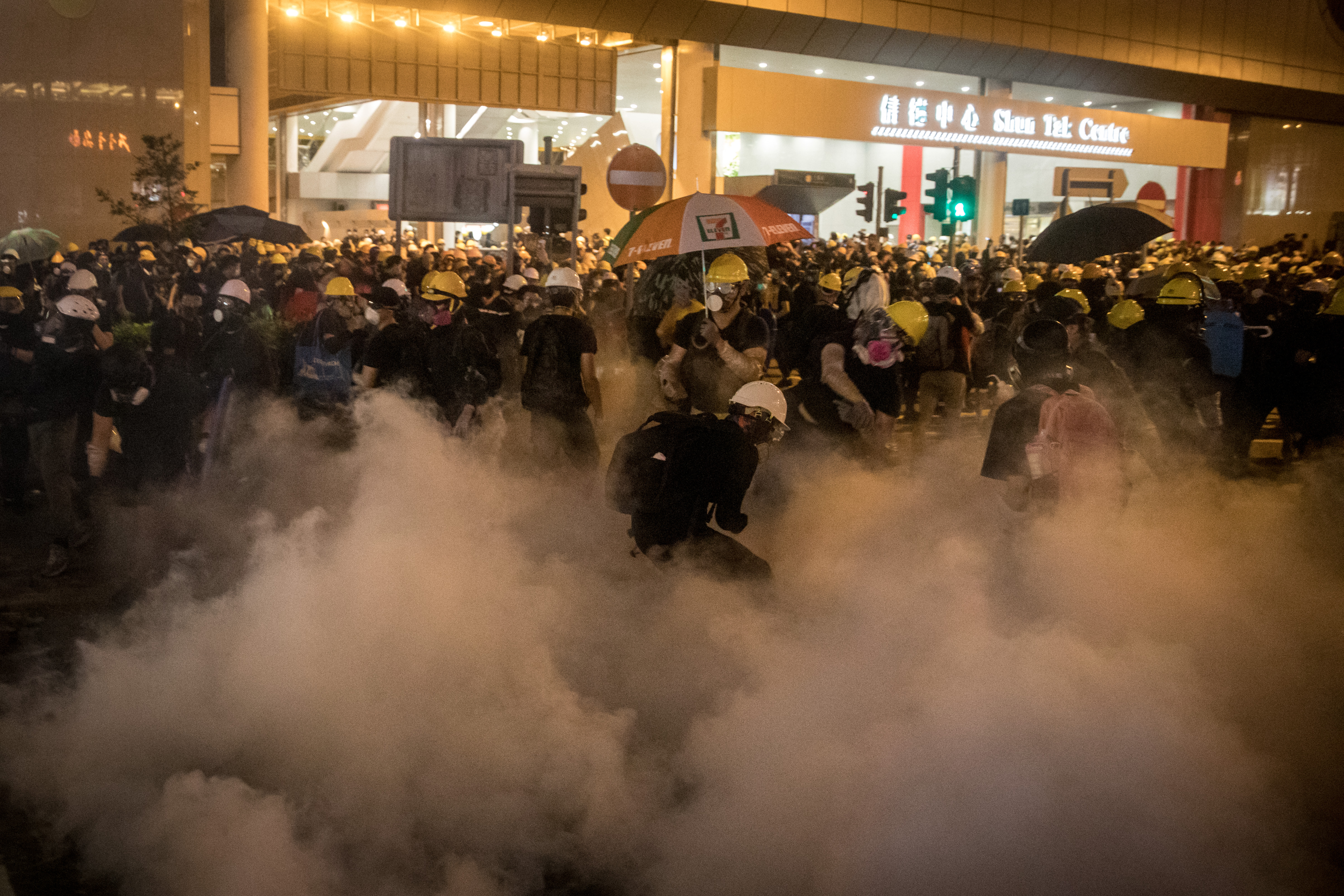 Police spray tear gas at protesters clash at an anti-extradition bill march on July 21, 2019 in Hong Kong.