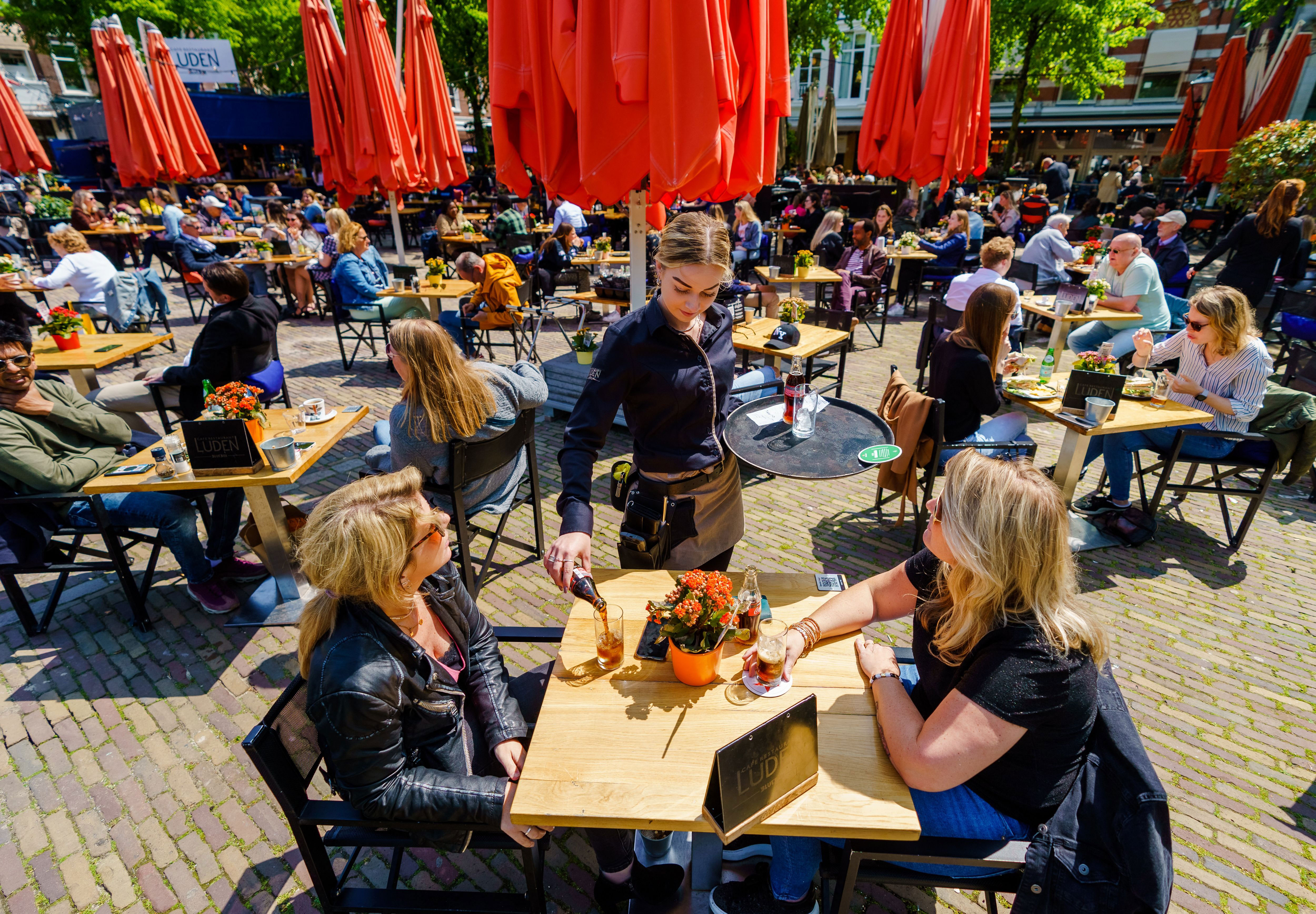 People dine at a cafe in The Hague, Netherlands, on May 28, 2021.