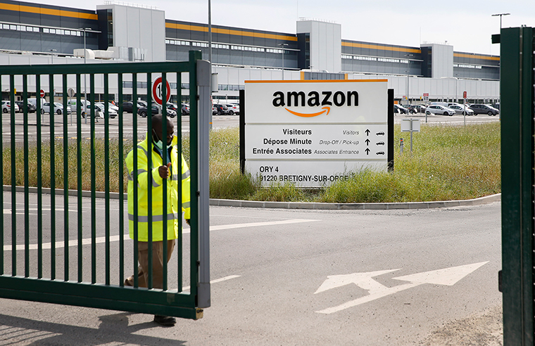 The entrance of an Amazon logistics center on Tuesday, April 21, in Bretigny-sur-Orge, France.