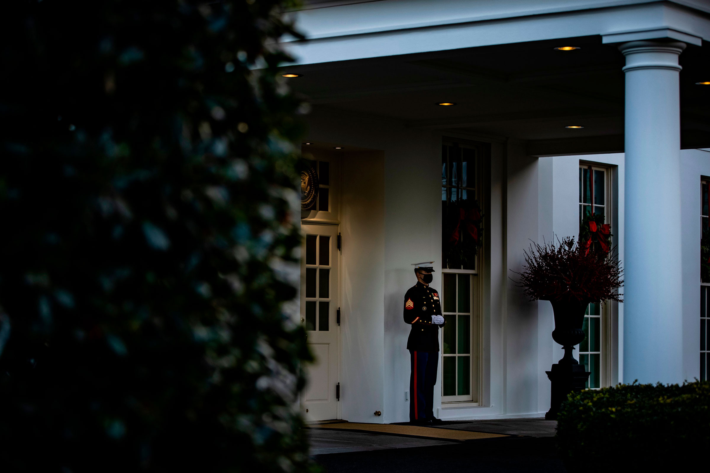 A US Marine stands guard outside the West Wing of the White House on Monday.