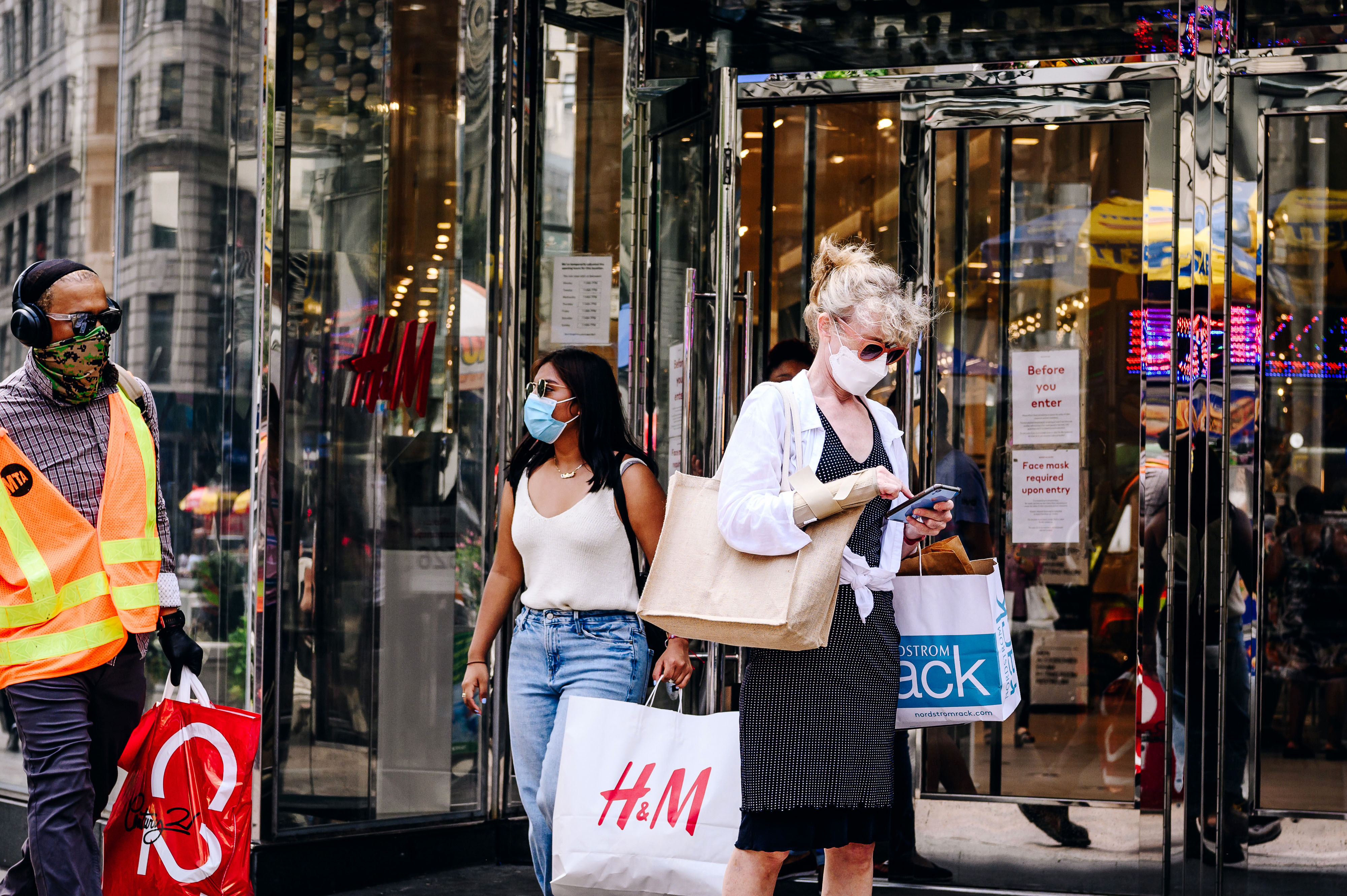 People shop in the Herald Square area of New York City on August 6.