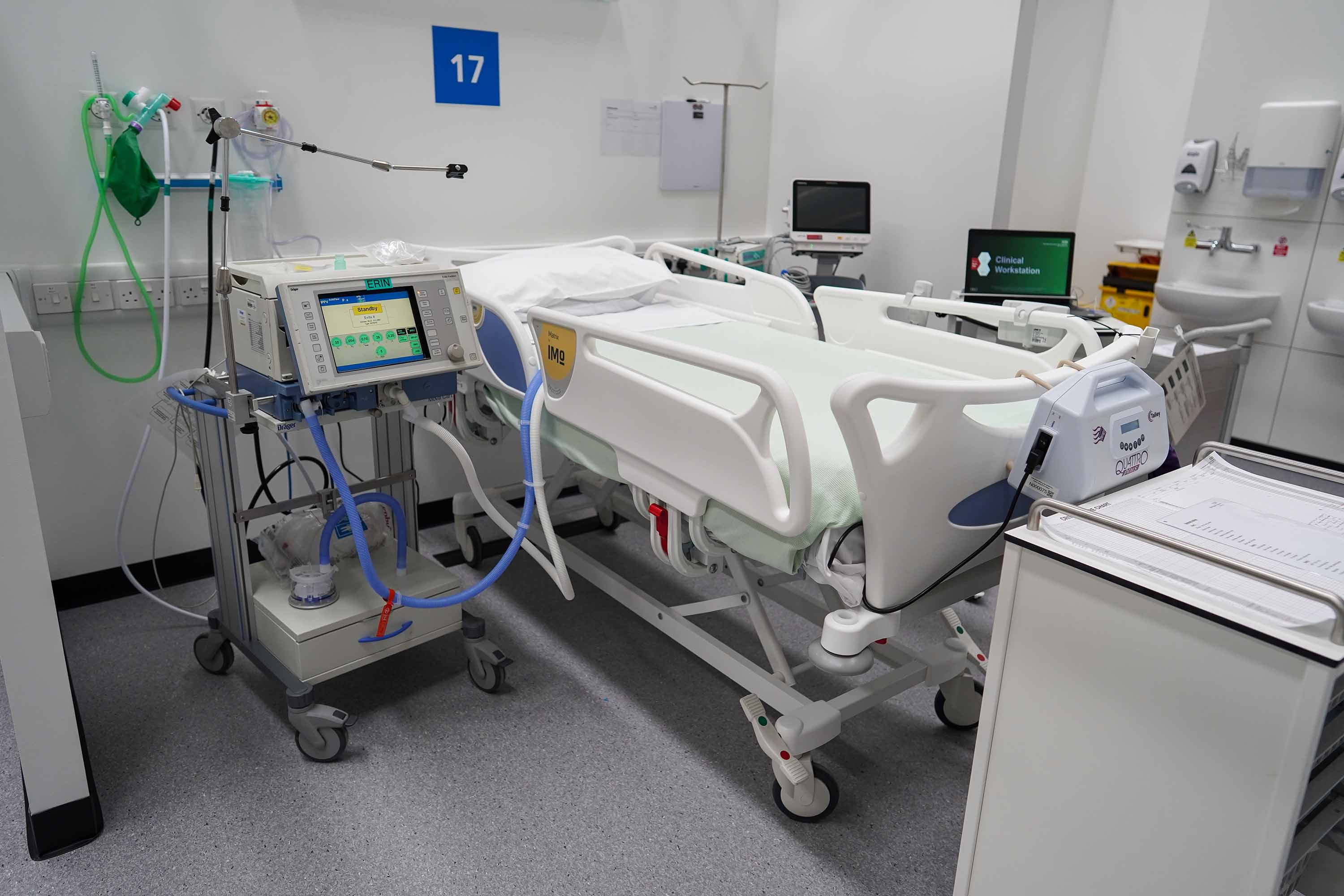 A ventilator, left, is set up beside a hospital bed at the NHS Nightingale North East hospital on May 4, 2020, in Sunderland, England.
