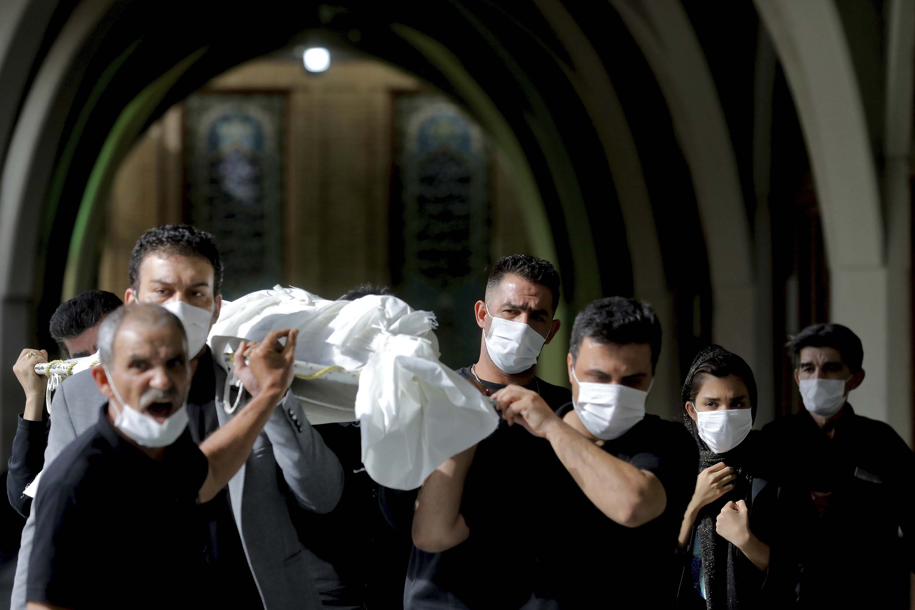 Mourners carry the body of a person who died from Covid-19 at the Behesht-e-Zahra cemetery on the outskirts of Tehran, Iran, on November 1.