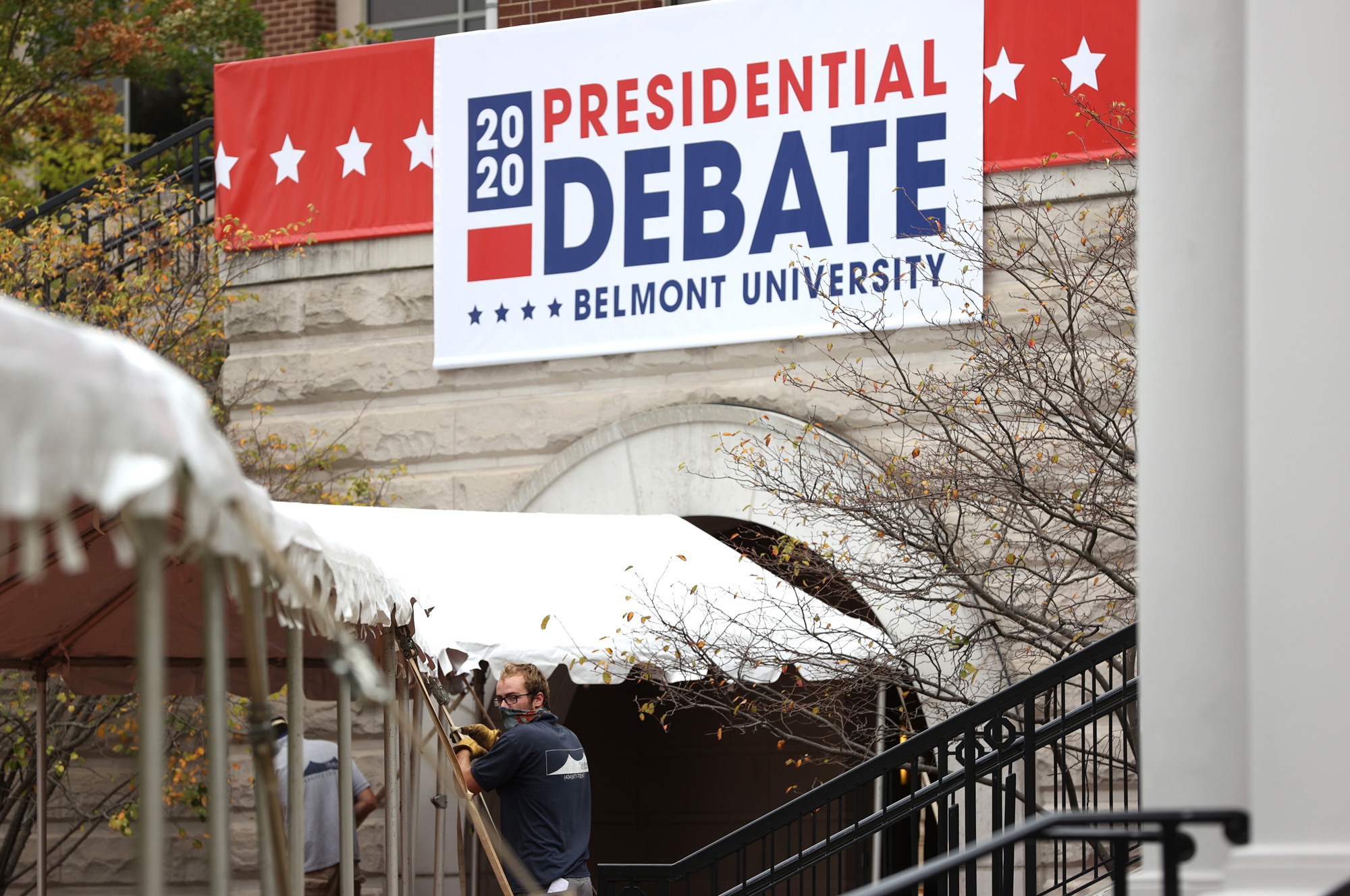 Workers set up a tent outside of the Curb Event Center at Belmont University on October 19 in Nashville, Tennessee.