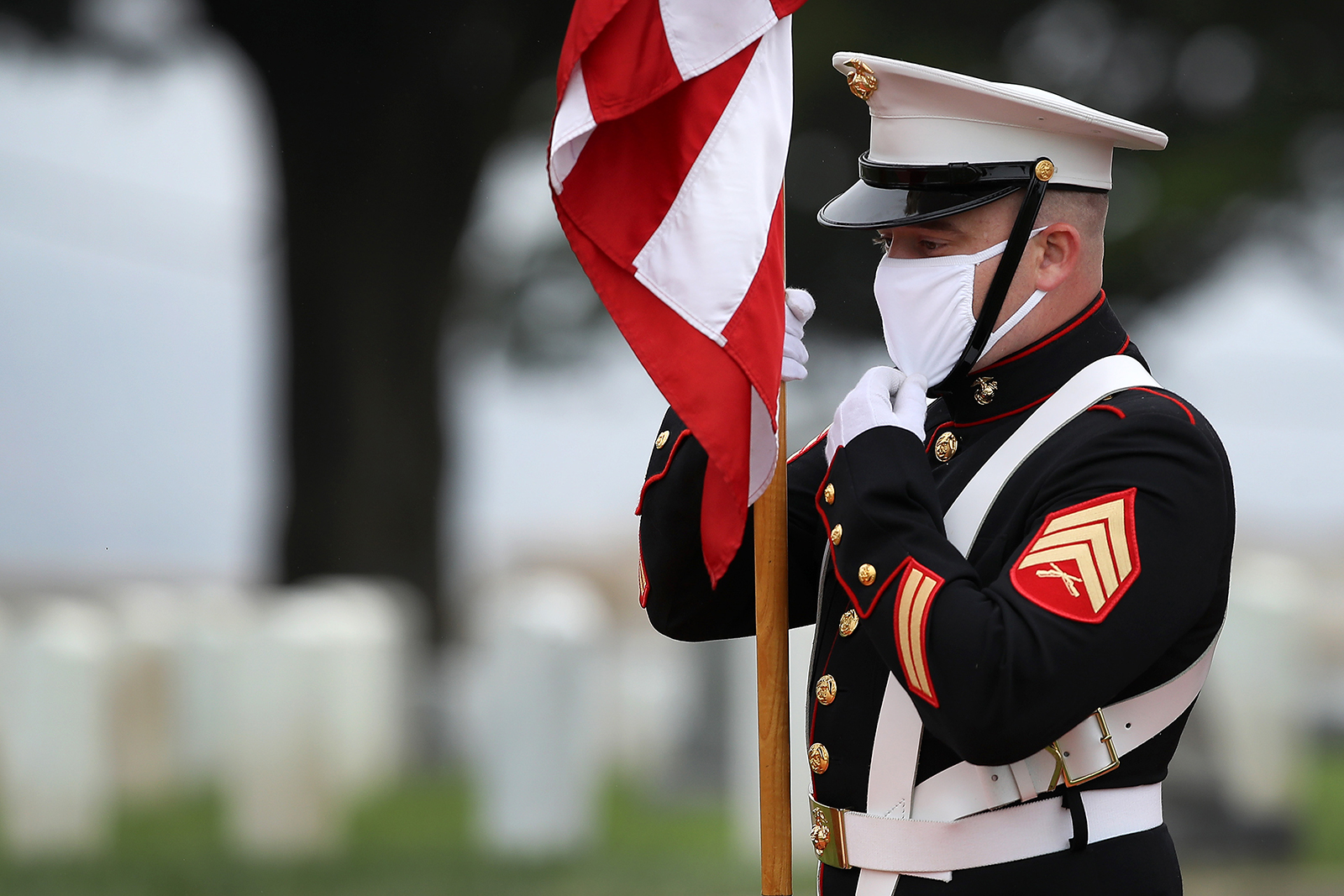 A Marine Color Guard presents colors during a Memorial Day ceremony at Fort Rosecrans National Cemetery on May 25, in San Diego, California.