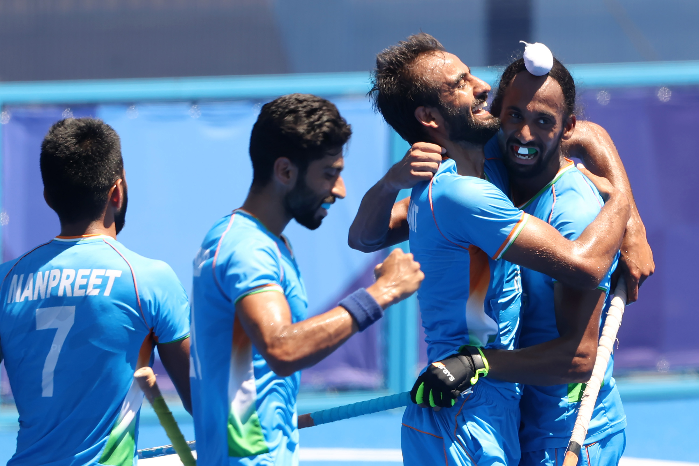 Members of India's hockey team celebrate after scoring a goal against Germany on Thursday, August 5.