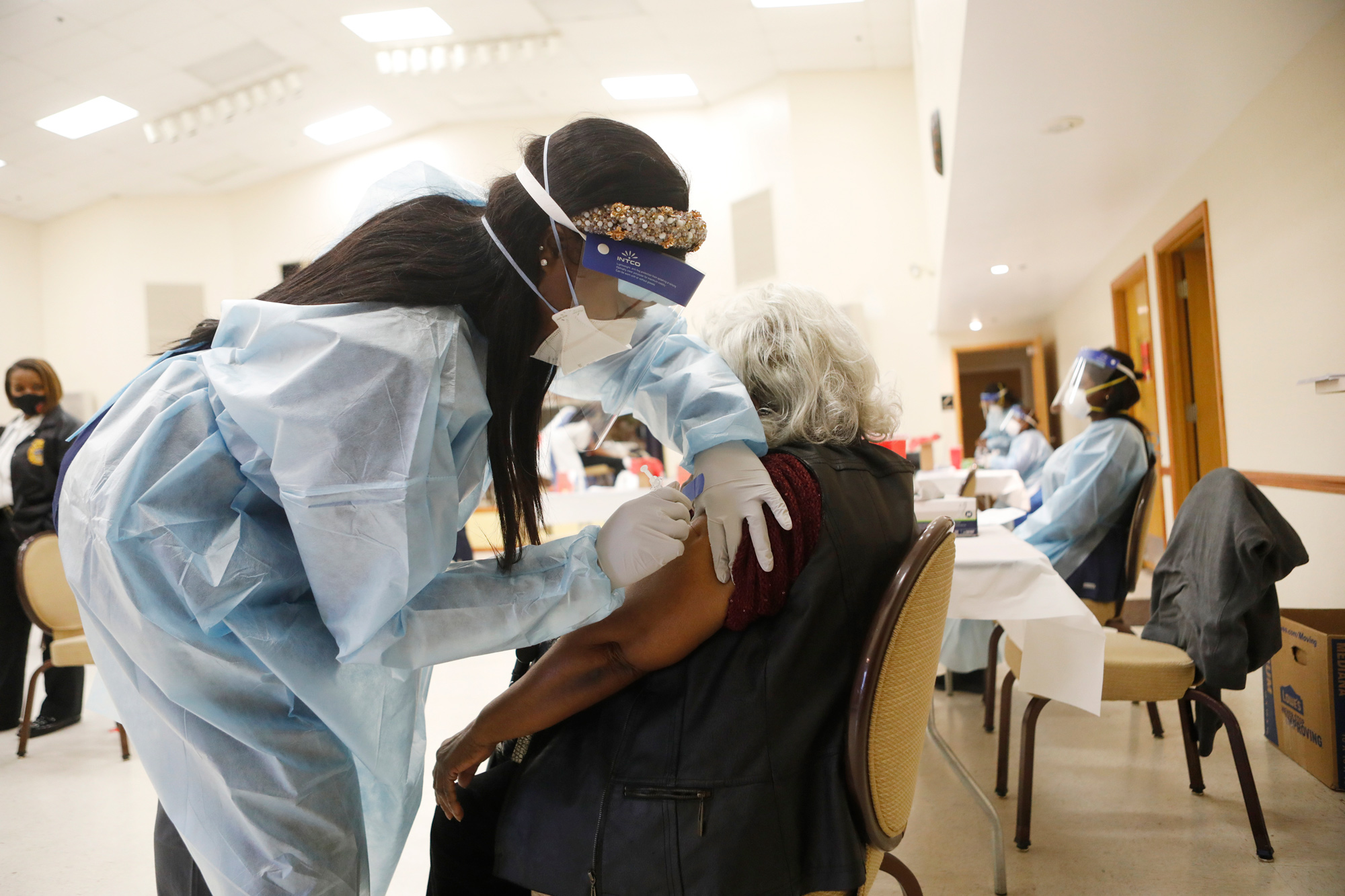 A healthcare worker administers the COVID-19 vaccine to residents living in the Jackson Heights neighborhood at St. Johns Missionary Baptist Church on January 10 in Tampa, Florida.