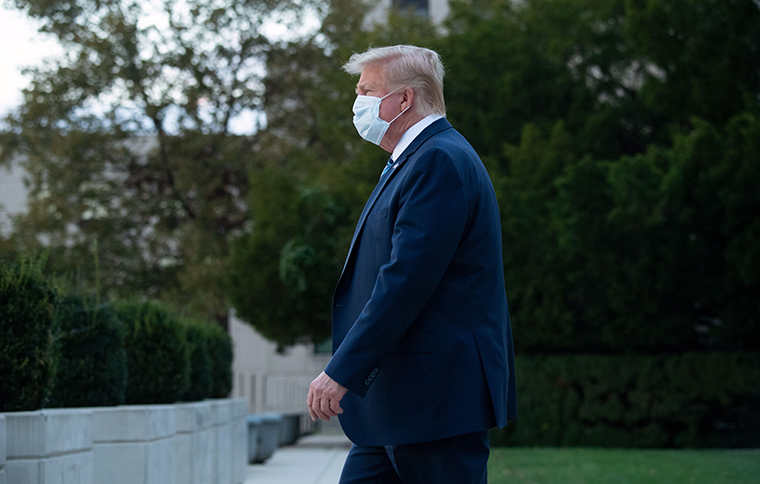 US President Donald Trump as he walked out of Walter Reed Medical Center in Bethesda, Maryland on October 5, 2020, to return to the White House after being discharged.