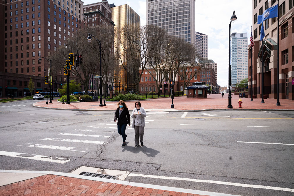 Women cross Market Street on Thursday, May 7 in downtown Hartford, Connecticut.
