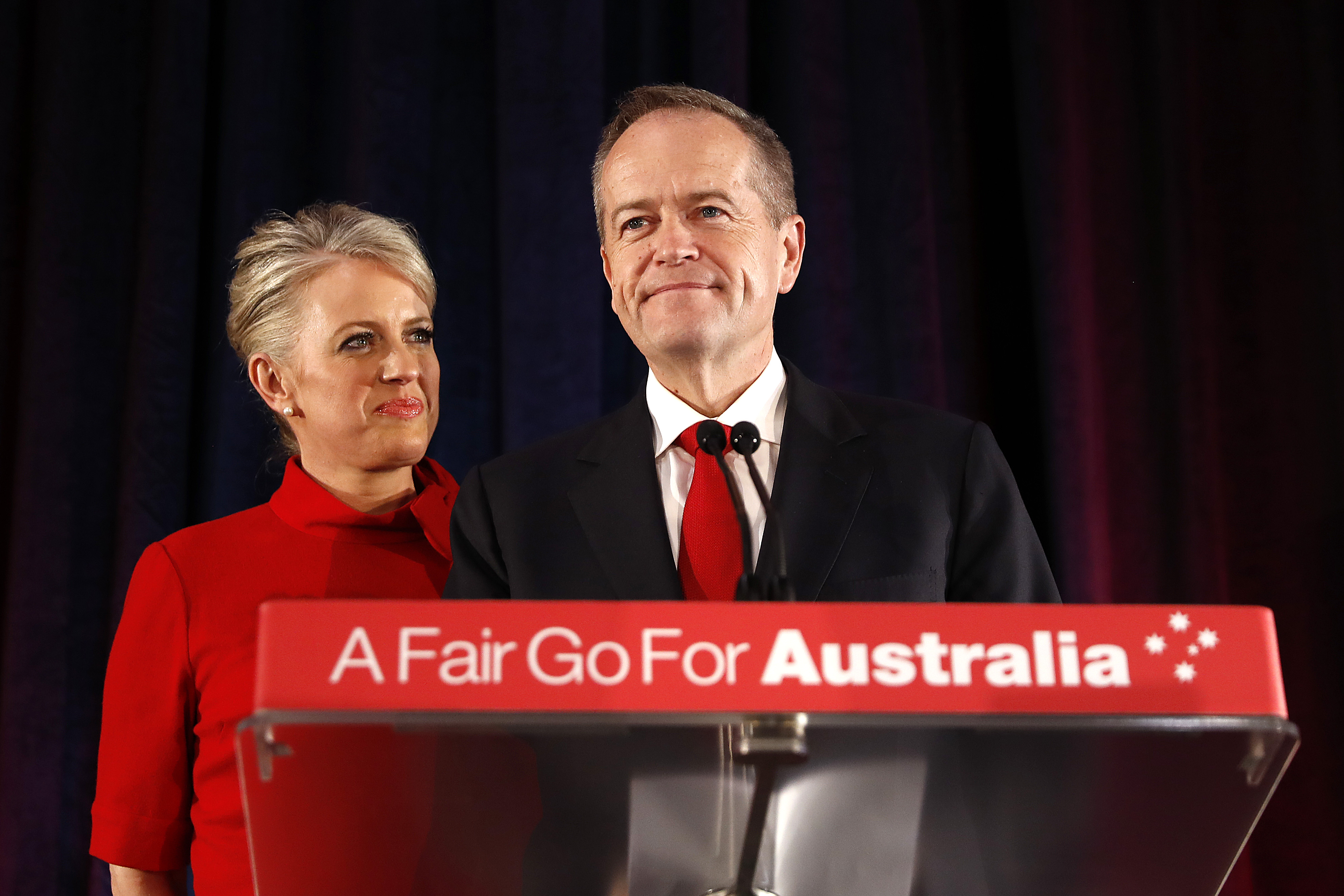 Bill Shorten, with his wife Chloe Shorten, concedes defeat in Melbourne on Saturday.