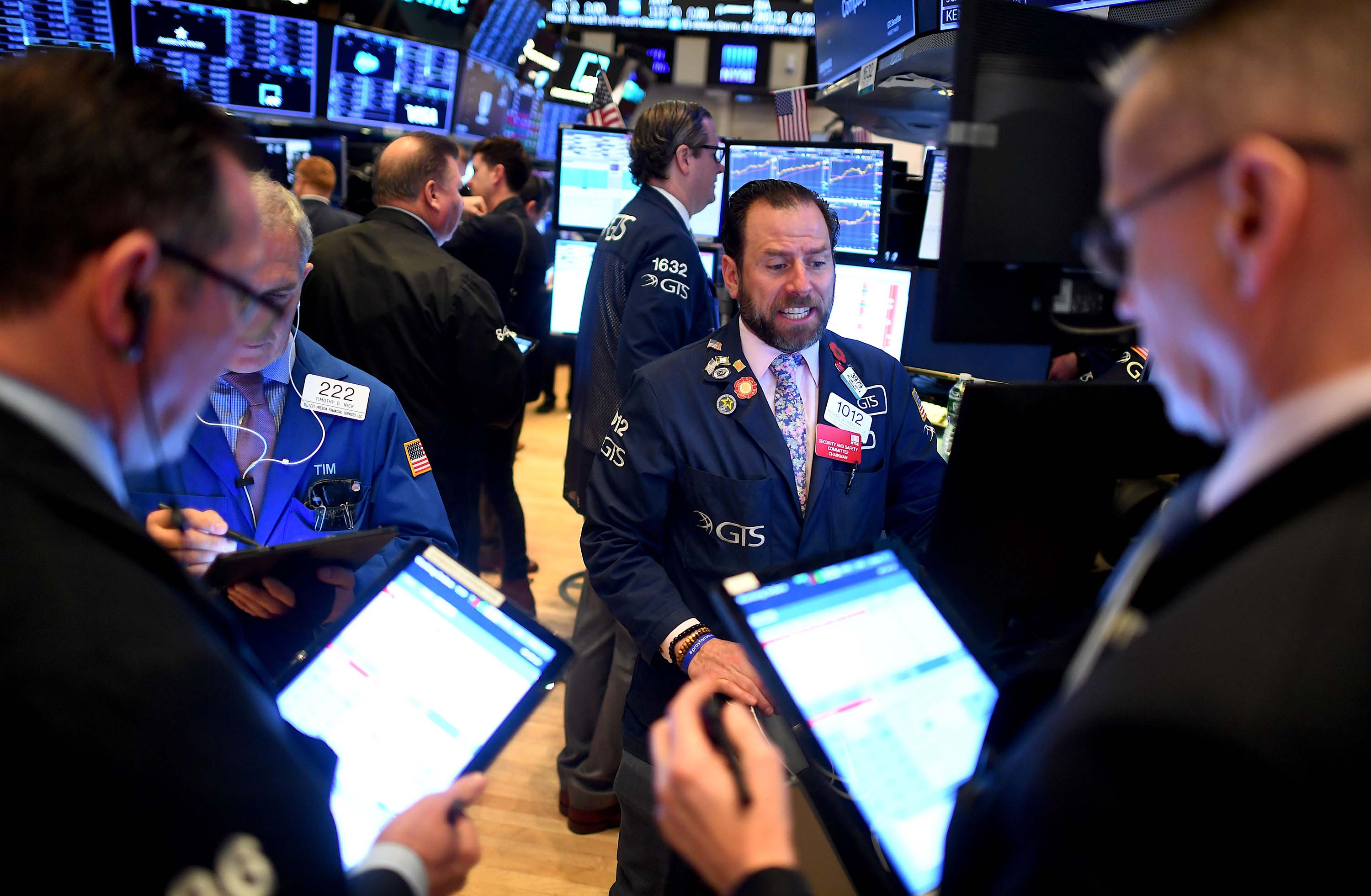 Traders work during the opening bell at the New York Stock Exchange on Thursday.