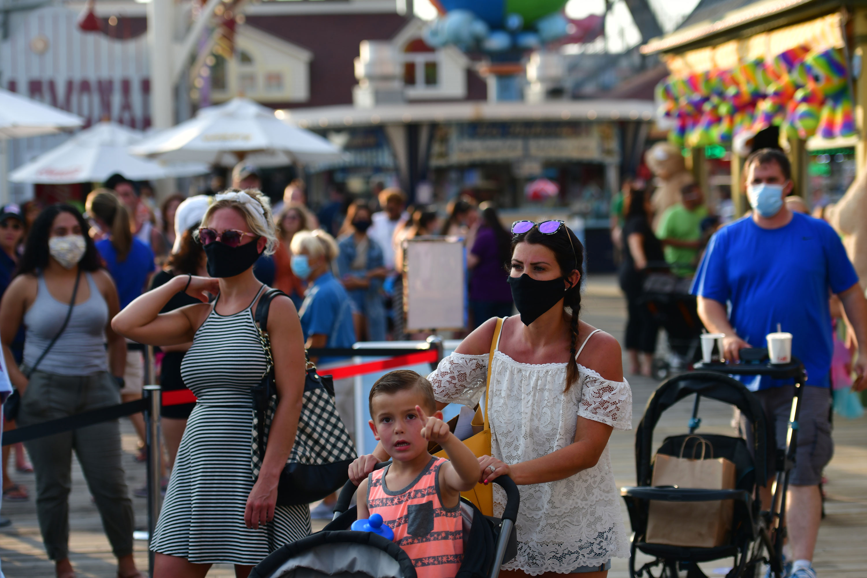 People wait in line at the entrance to an amusement pier on July 3 in Wildwood, New Jersey.