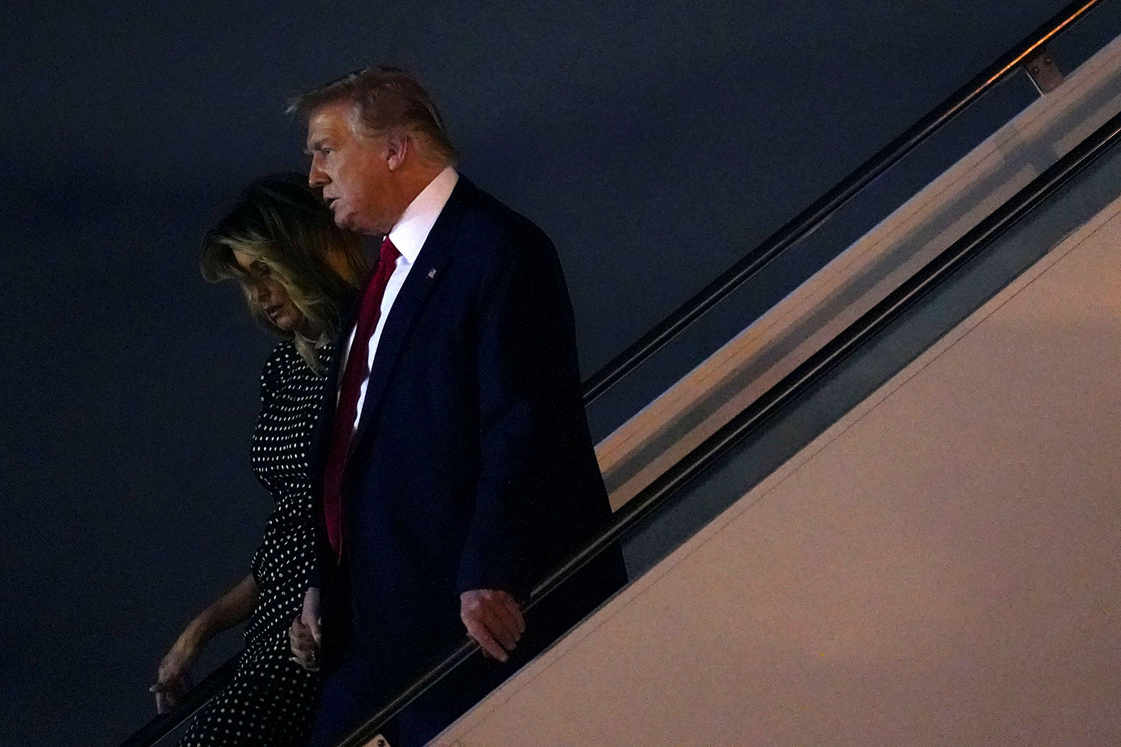 President Donald Trump and first lady Melania Trump disembark Air Force One at Palm Beach International Airport on Wednesday, December 23.