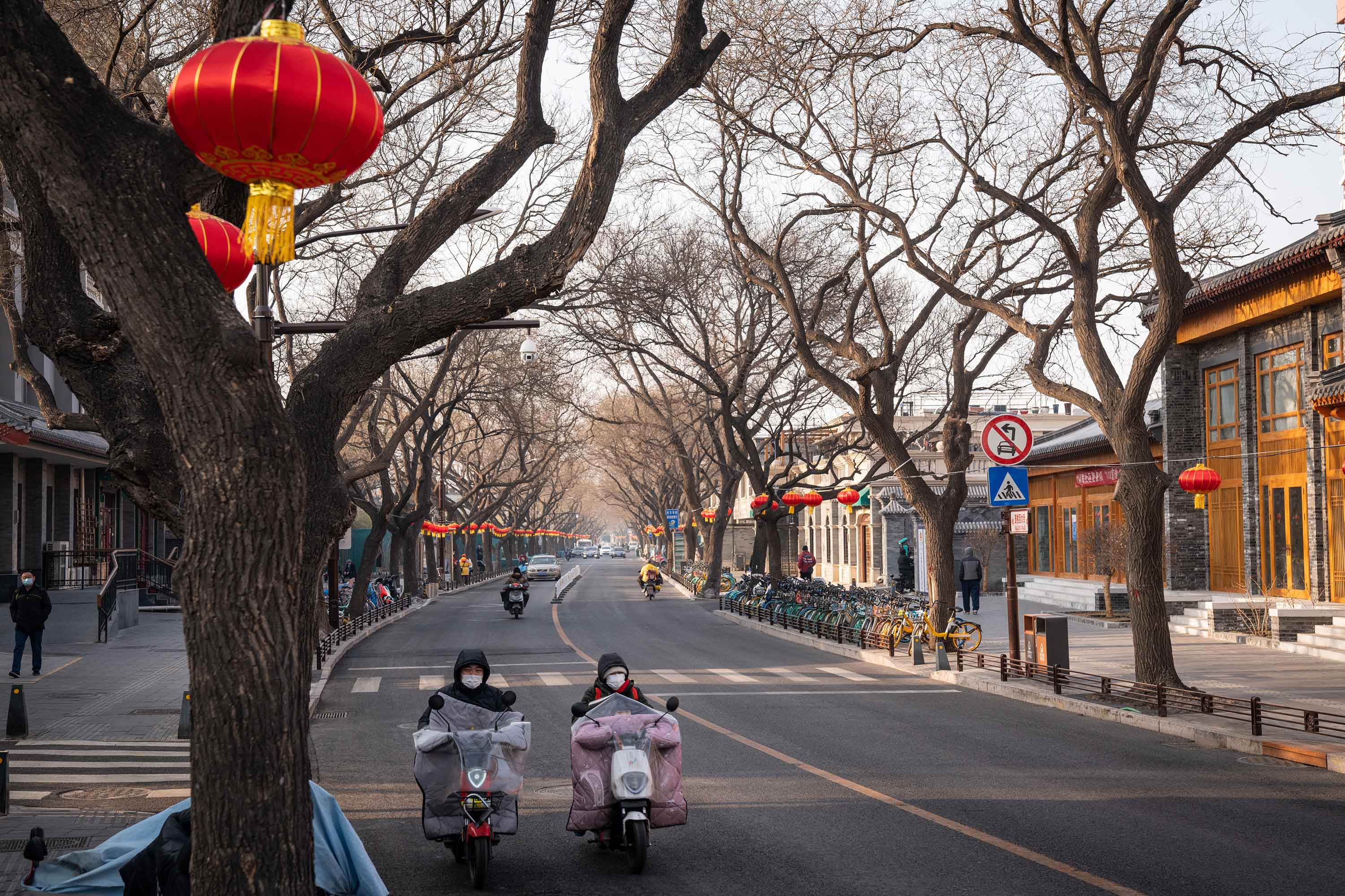 Motorists travel along street decorated for the Chinese New Year in Beijing, China, on January 26.